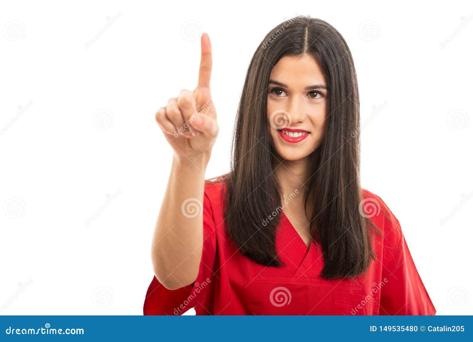 Ståenden av härligt bära för sjuksköterska som är rött, skurar genom att använda pekskärmen