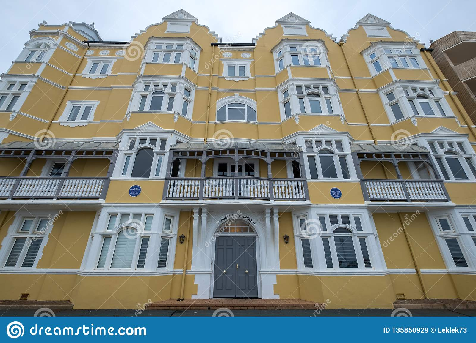 St Aubyns Mansions on Kings Esplanade, Hove, East Sussex, UK. Restored mustard coloured block of flats overlooking the sea
