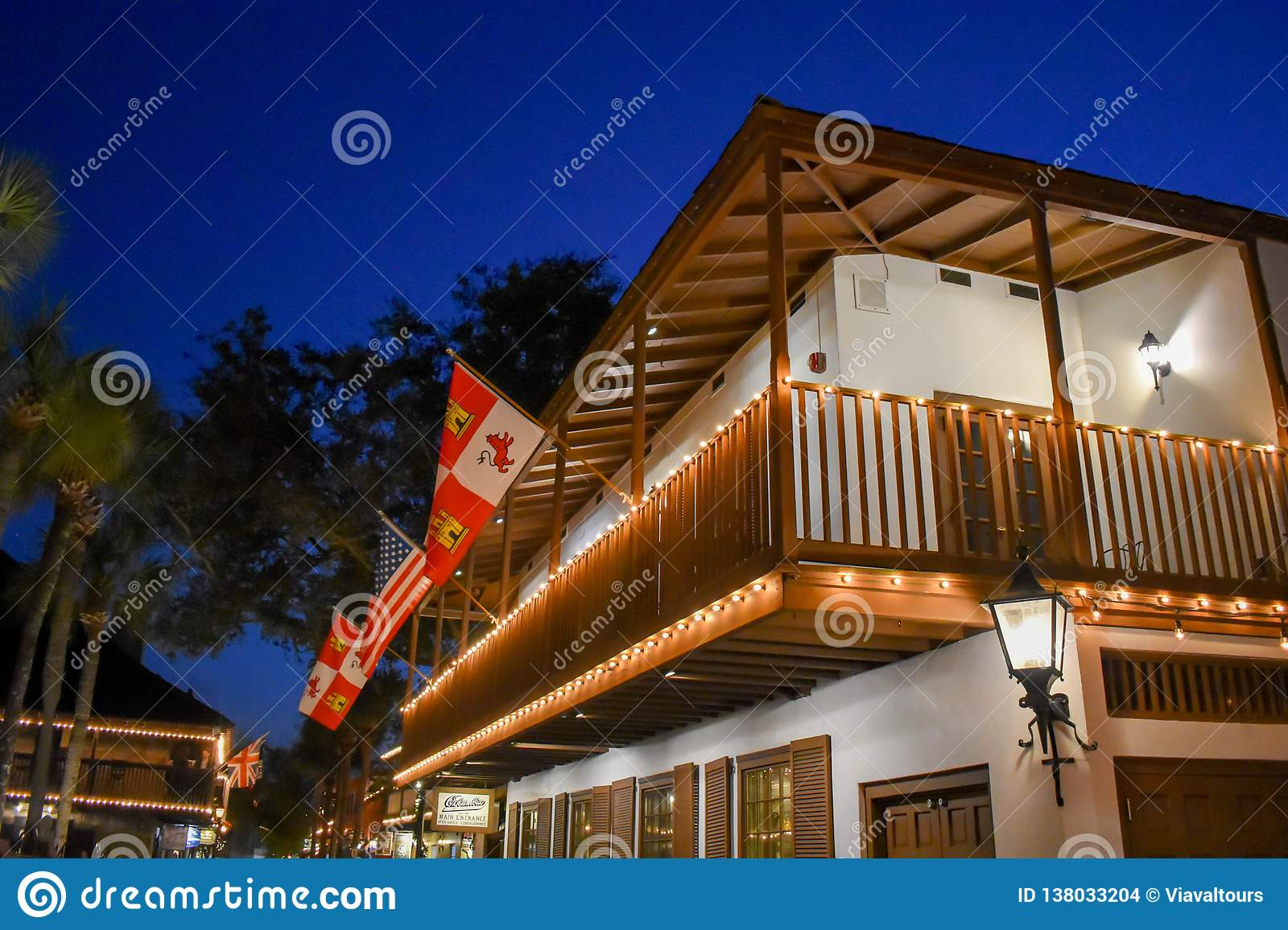 Top view of restaurant in seventeenth century house adn Flags at Old Town in Florida`s Historic Coast .