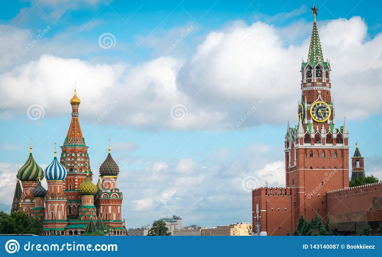 St. Basil`s Cathedral and Spasskaya Bashnya at Red Square in Moscow, Russia.