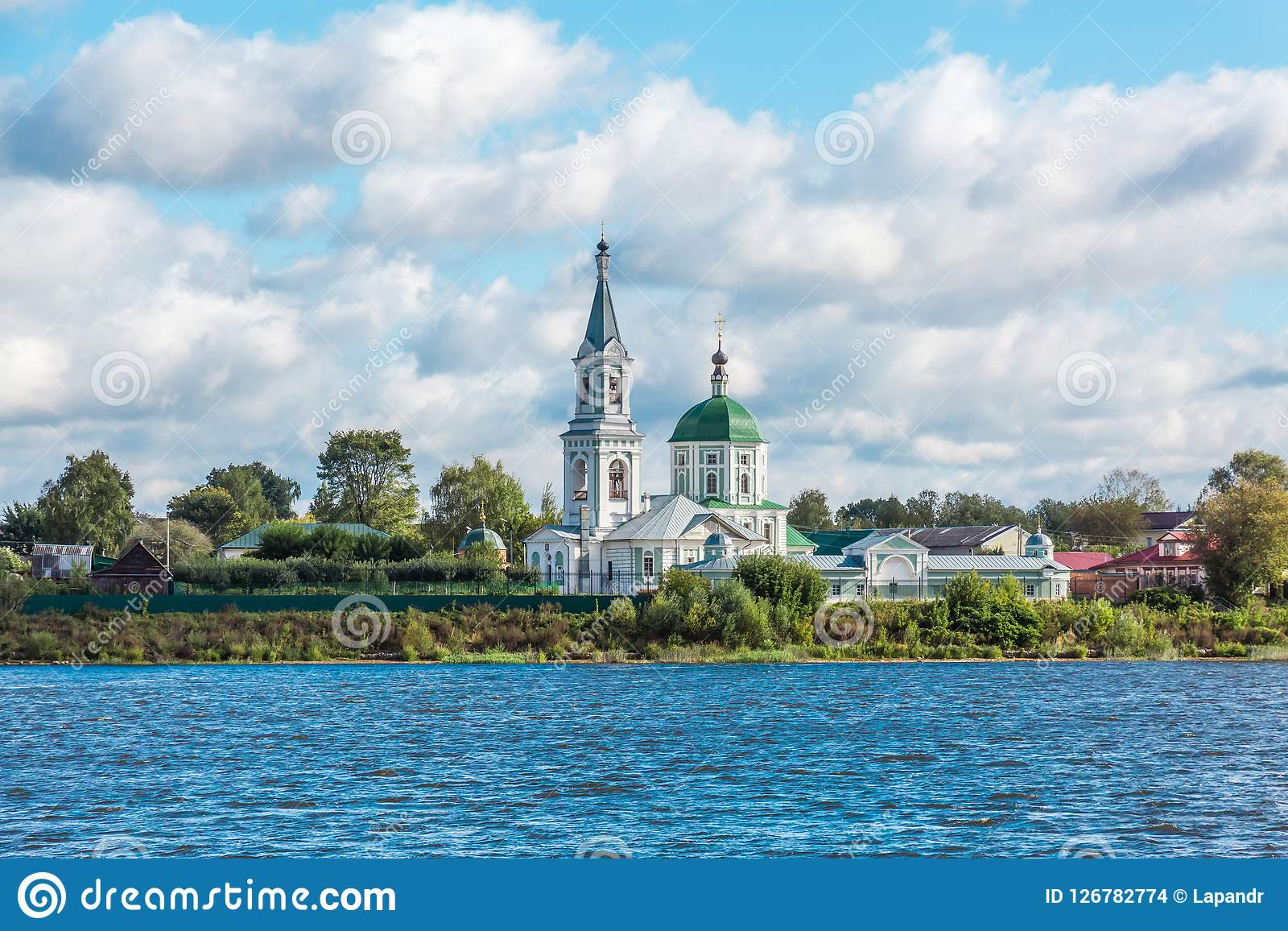 St. Catherine`s convent. Russia, the city Tver. View of the monastery from the Volga river. Picturesque clouds in the sky