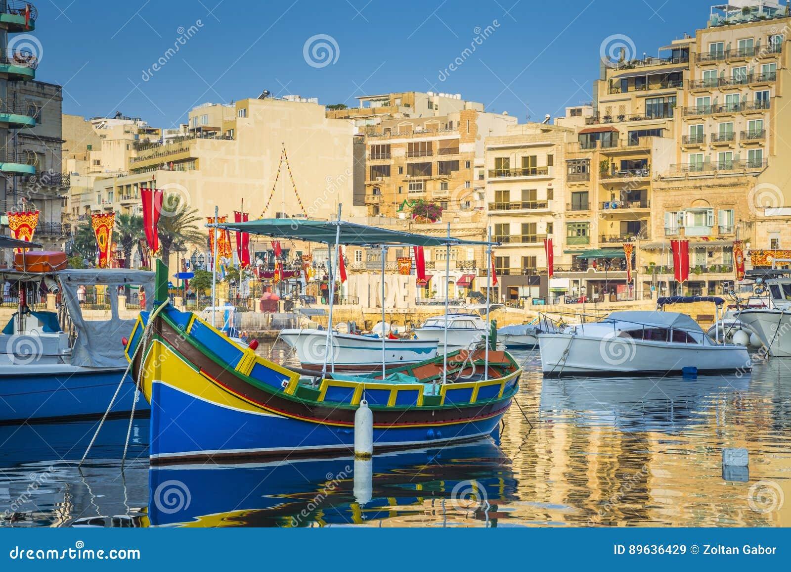 St.Julian`s, Malta - Colorful Luzzu fishing boats at Spinola bay