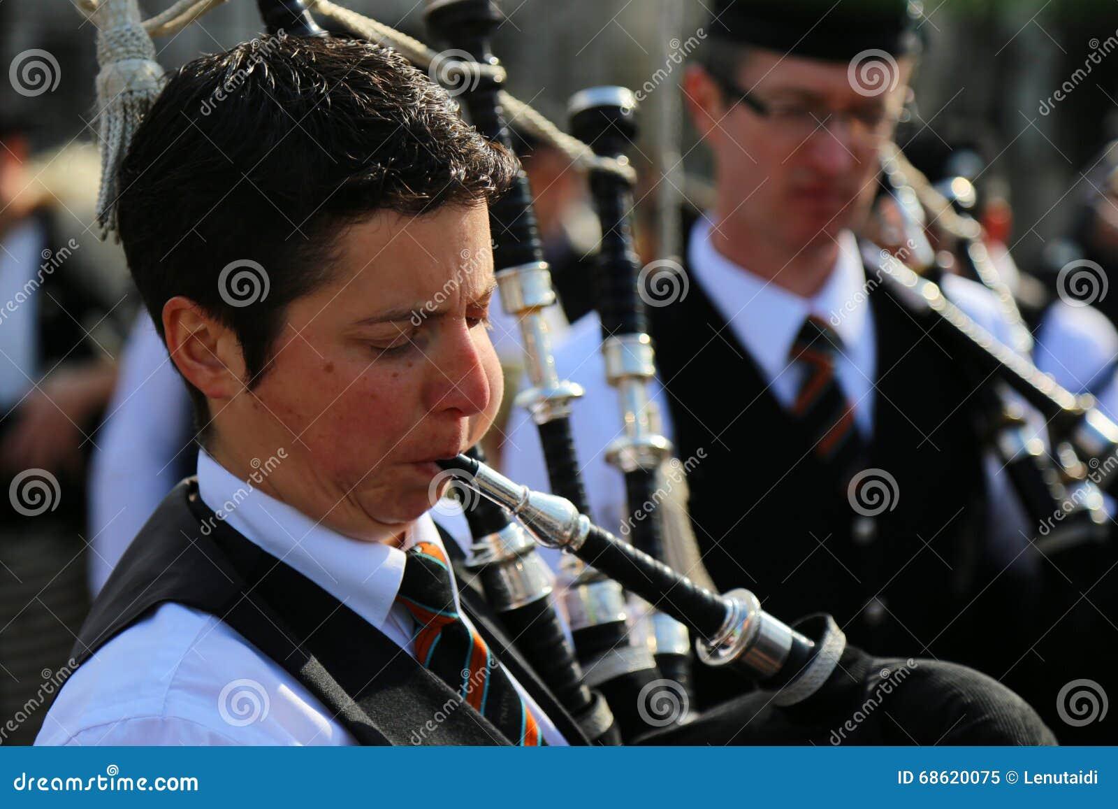 St Patrick parade - bagpiper