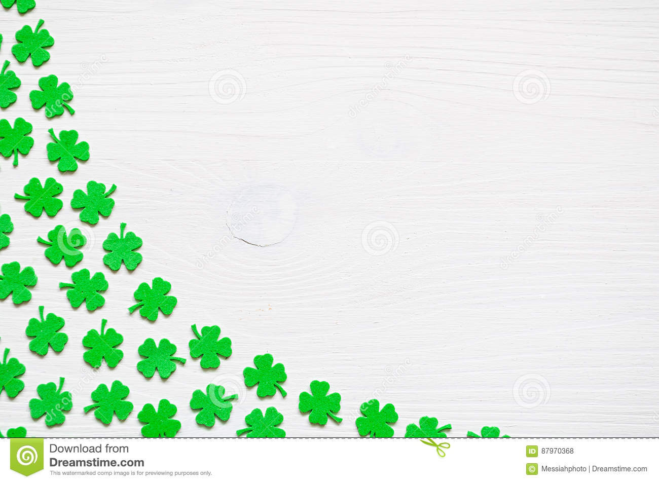 St Patrick`s Day background with green quatrefoils