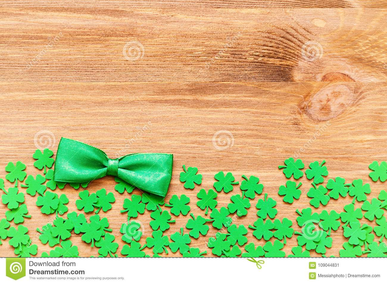 St Patrick`s Day background with green quatrefoils and green bow tie