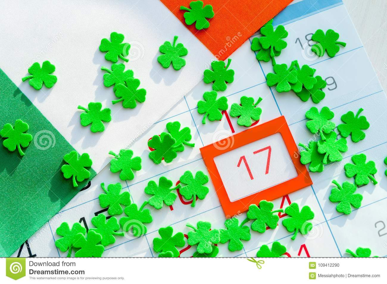 St Patrick`s Day festive background. Green quatrefoils and Irish flag covering the calendar with framed 17 March