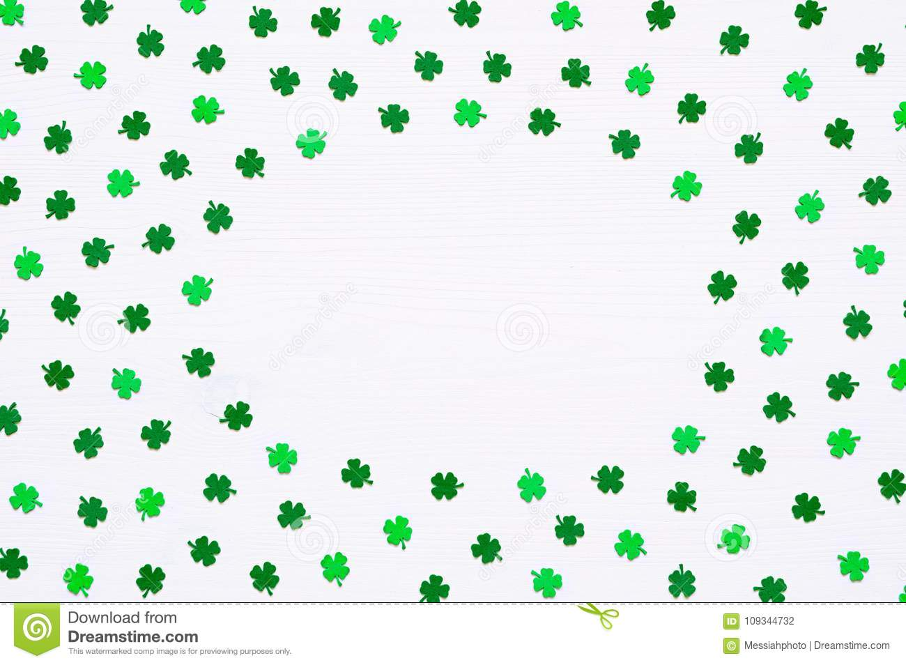 St Patrick`s Day background with green quatrefoils on white background, round border