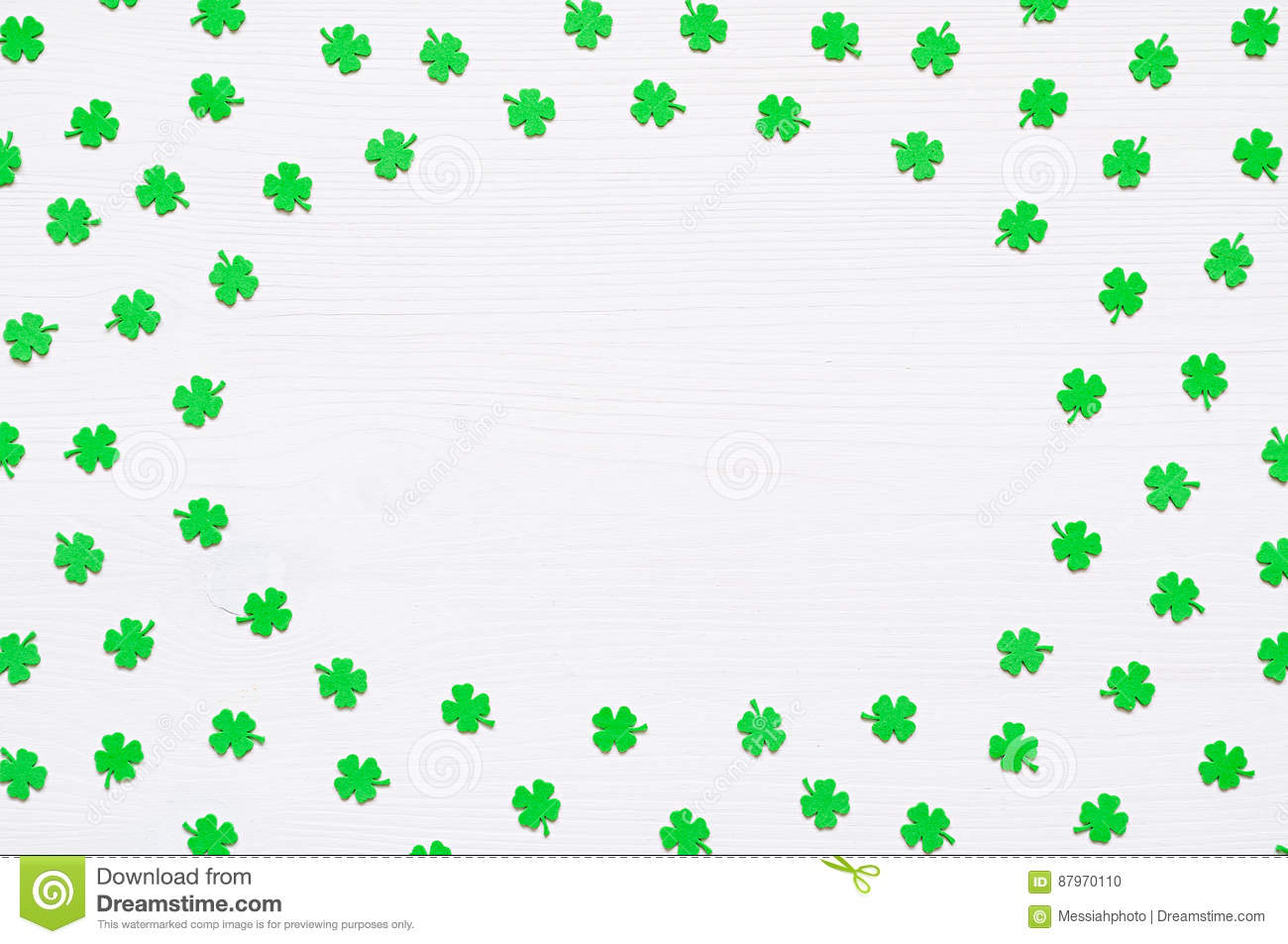 St Patrick`s Day background with green quatrefoils on white background