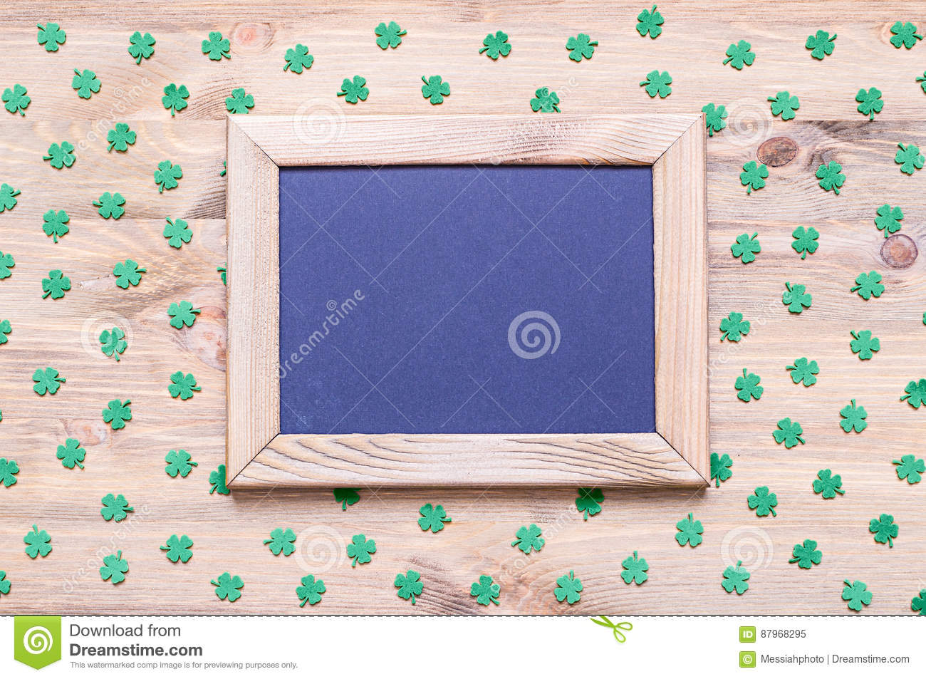 St Patrick`s Day background with green quatrefoils on the wooden background