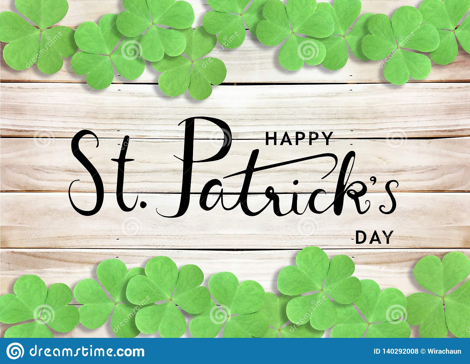 Happy St. Patrick`s Day Black Text Typography Background with Green Shamrocks on Wooden Texture