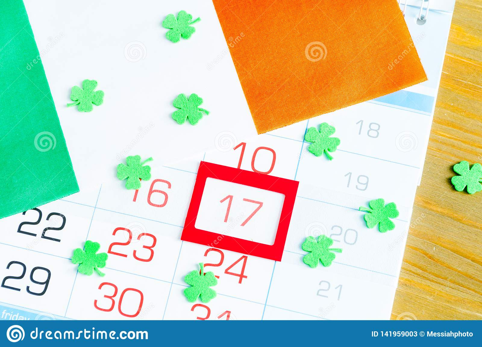 St Patrick`s Day festive background. Green quatrefoils and the Irish national flag, St Patrick`s day holiday concept
