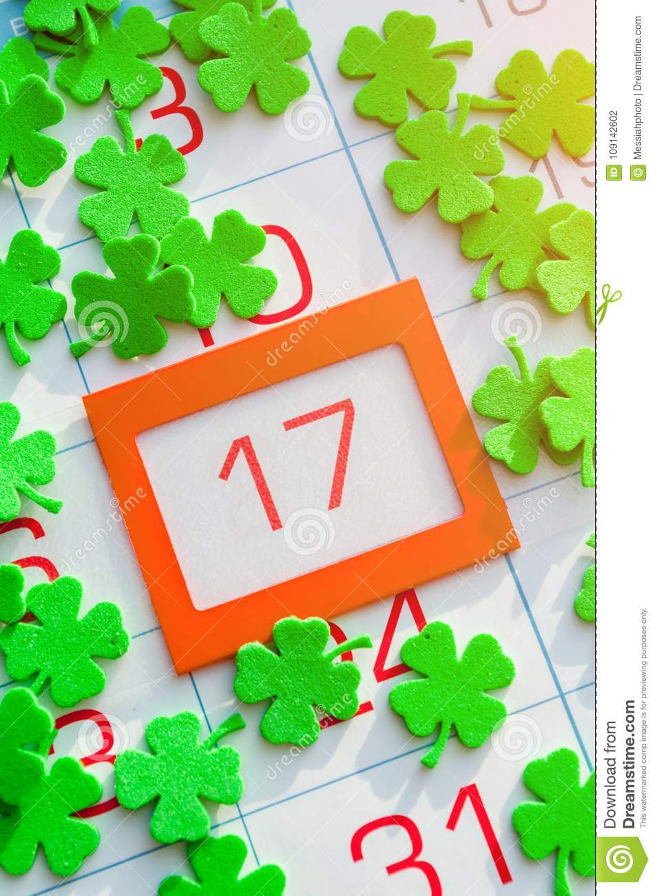 St Patrick`s Day festive card. Green quatrefoils on the calendar with orange framed 17 March