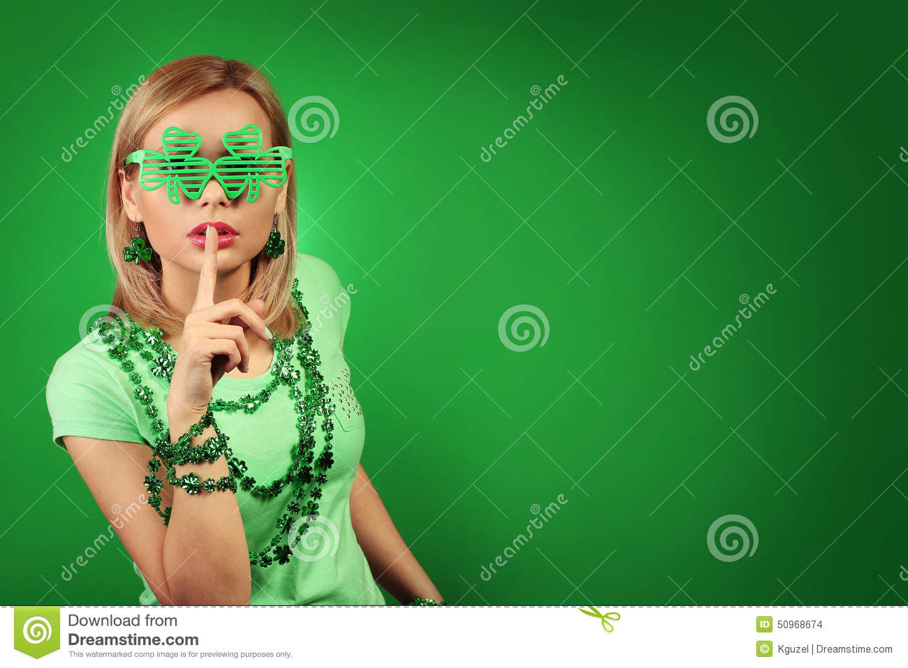 St Patrick s day Girl. Young woman with shamrock shaped glasses