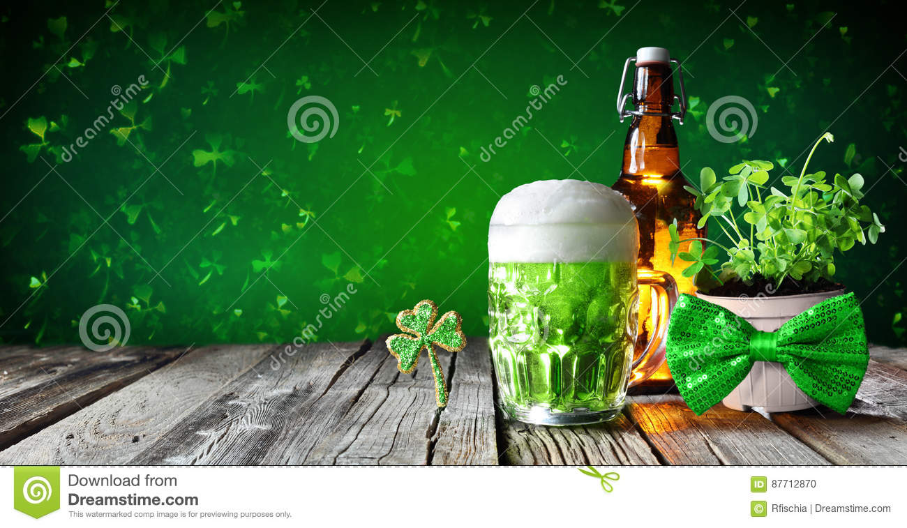 St Patrick`s Day - Green Beer In Glass With Bottle And Clovers