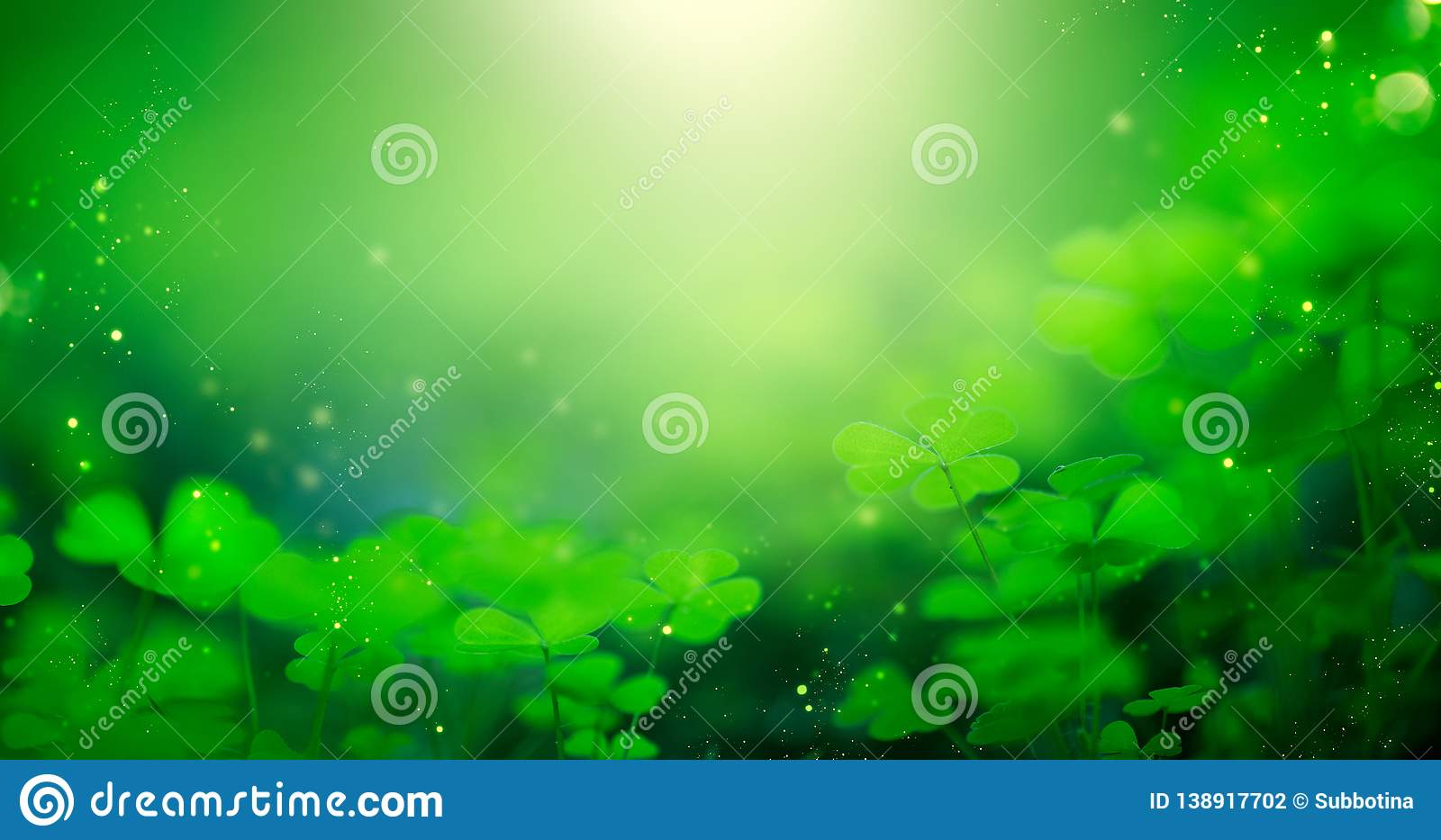 St. Patrick`s Day green blurred background with shamrock leaves. Patrick Day. Abstract border art design. Magic clover