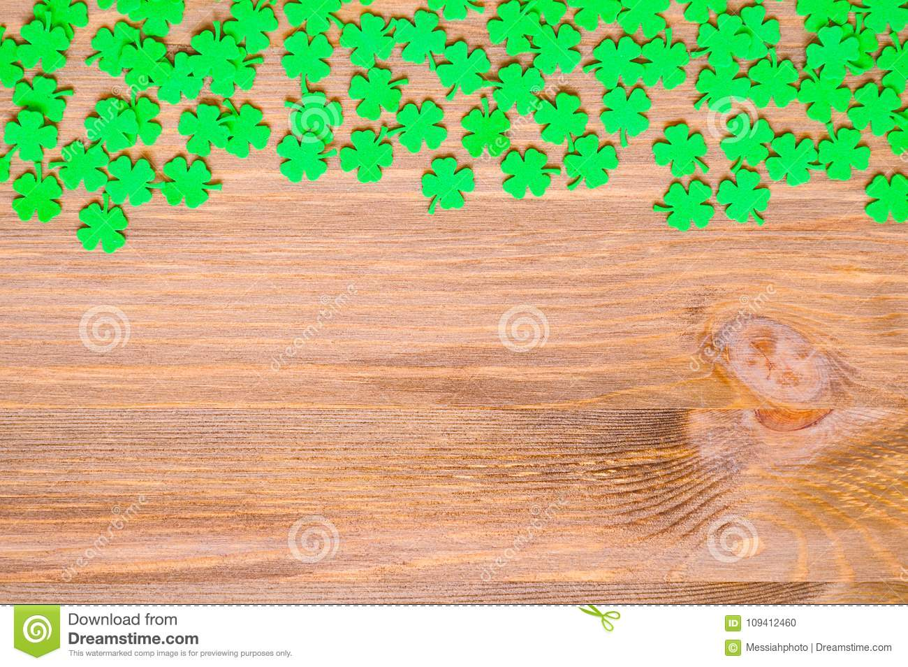 St Patrick`s Day background with one side border of green quatrefoils and free space for text