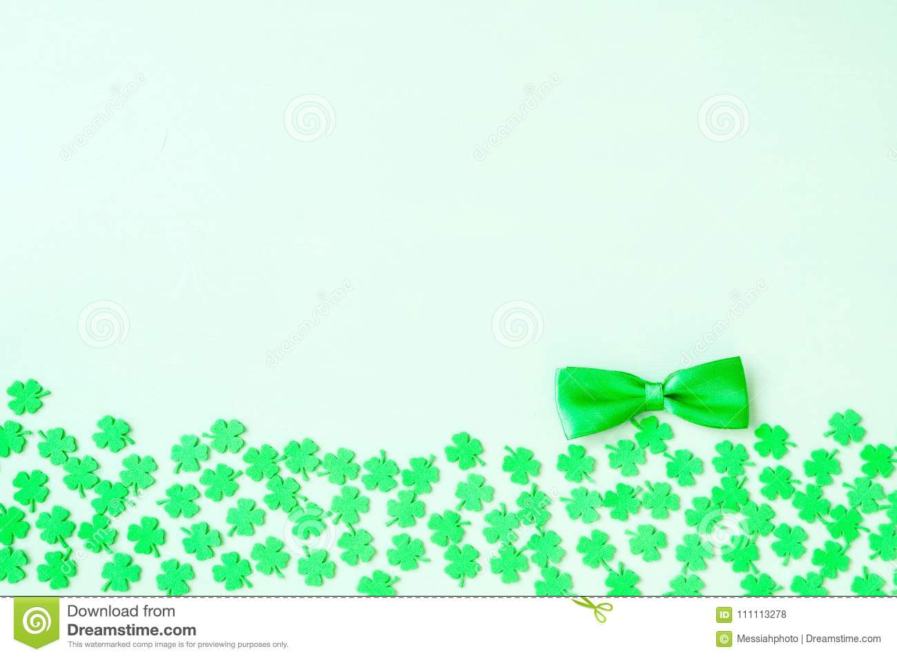 St Patricks Day background - green quatrefoils and bow tie
