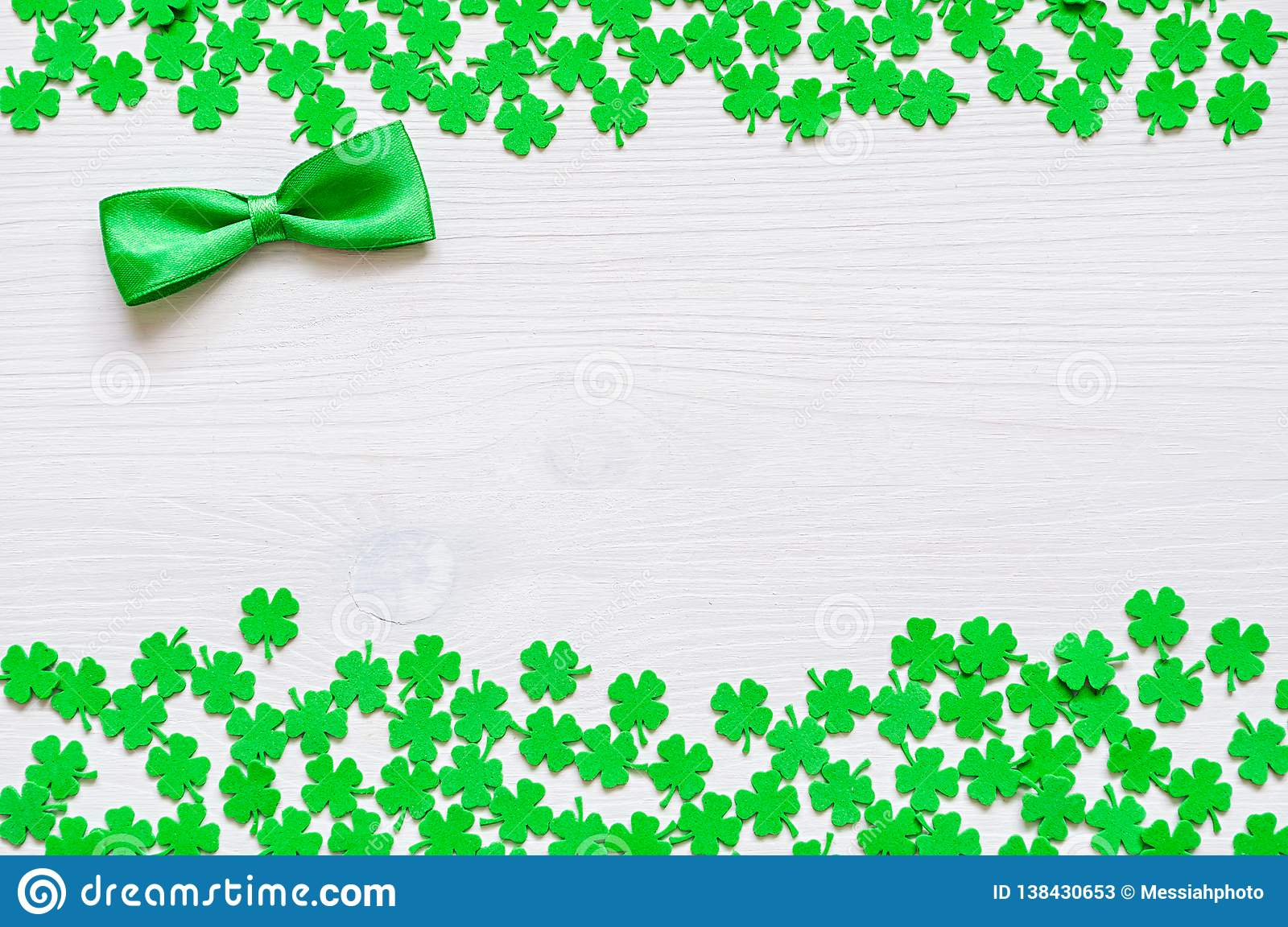 St Patricks Day background with green quatrefoils and green bow tie