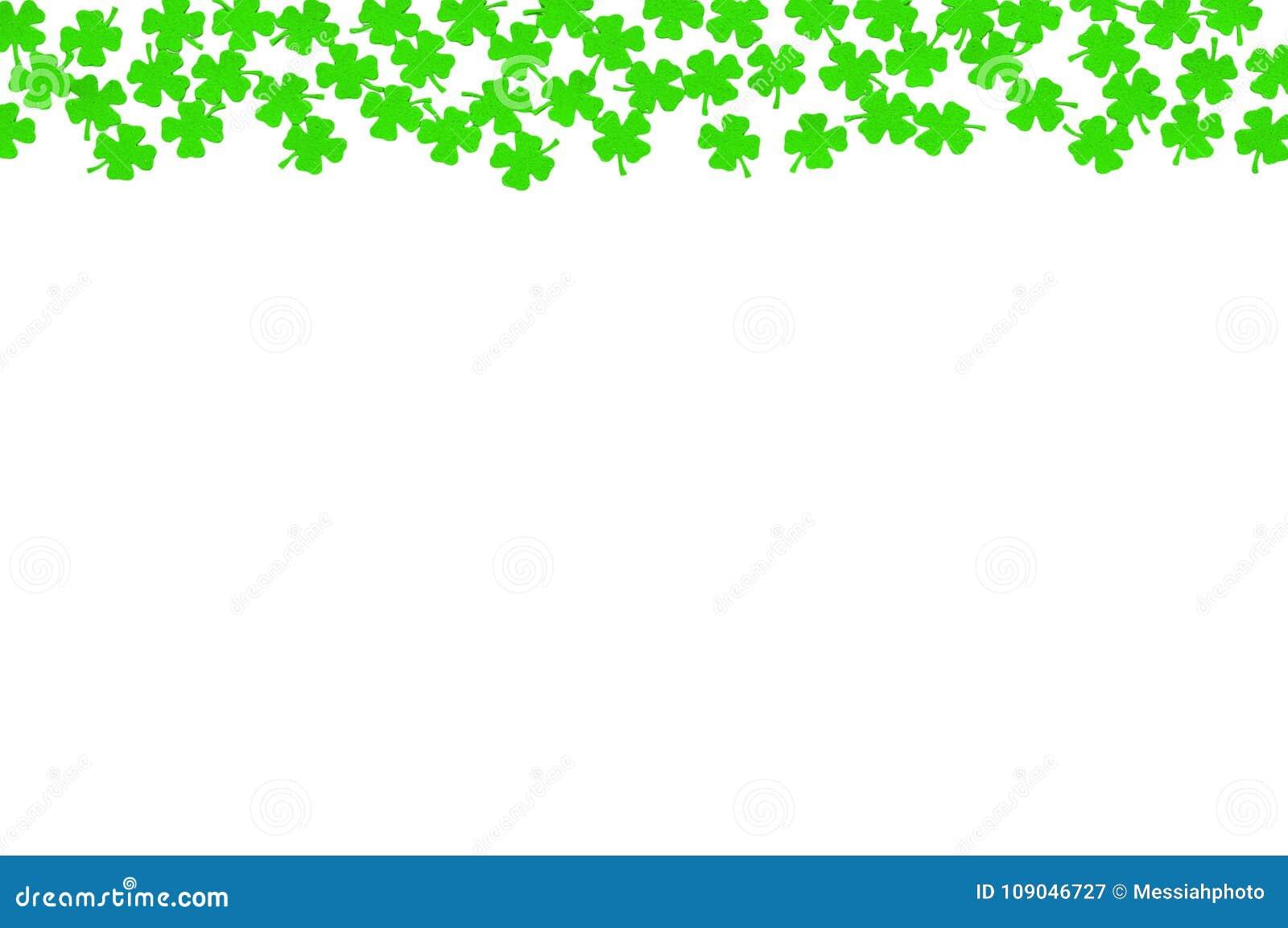 St Patricks Day festive background - upper border of green quatrefoils isolated on white