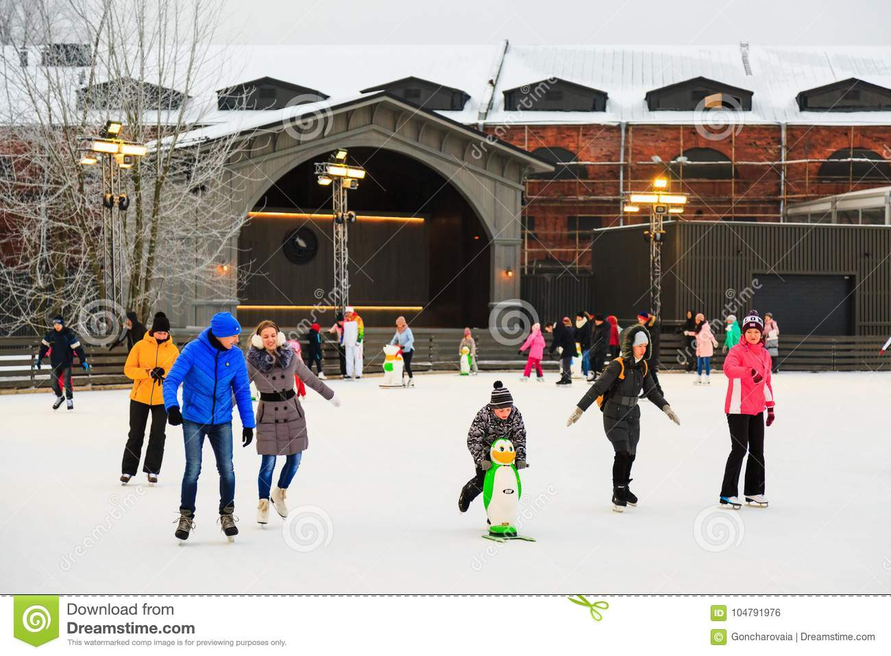 St. Petersburg, Russia -February 11, 2017: Ice skating rink in city at winter. People learning to skate. New Holland Island.