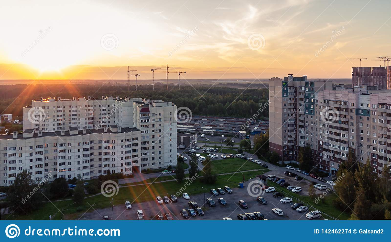 St. Petersburg, Russia - July 24, 2018: City landscape - high-rise buildings on the outskirts of the city at sunset