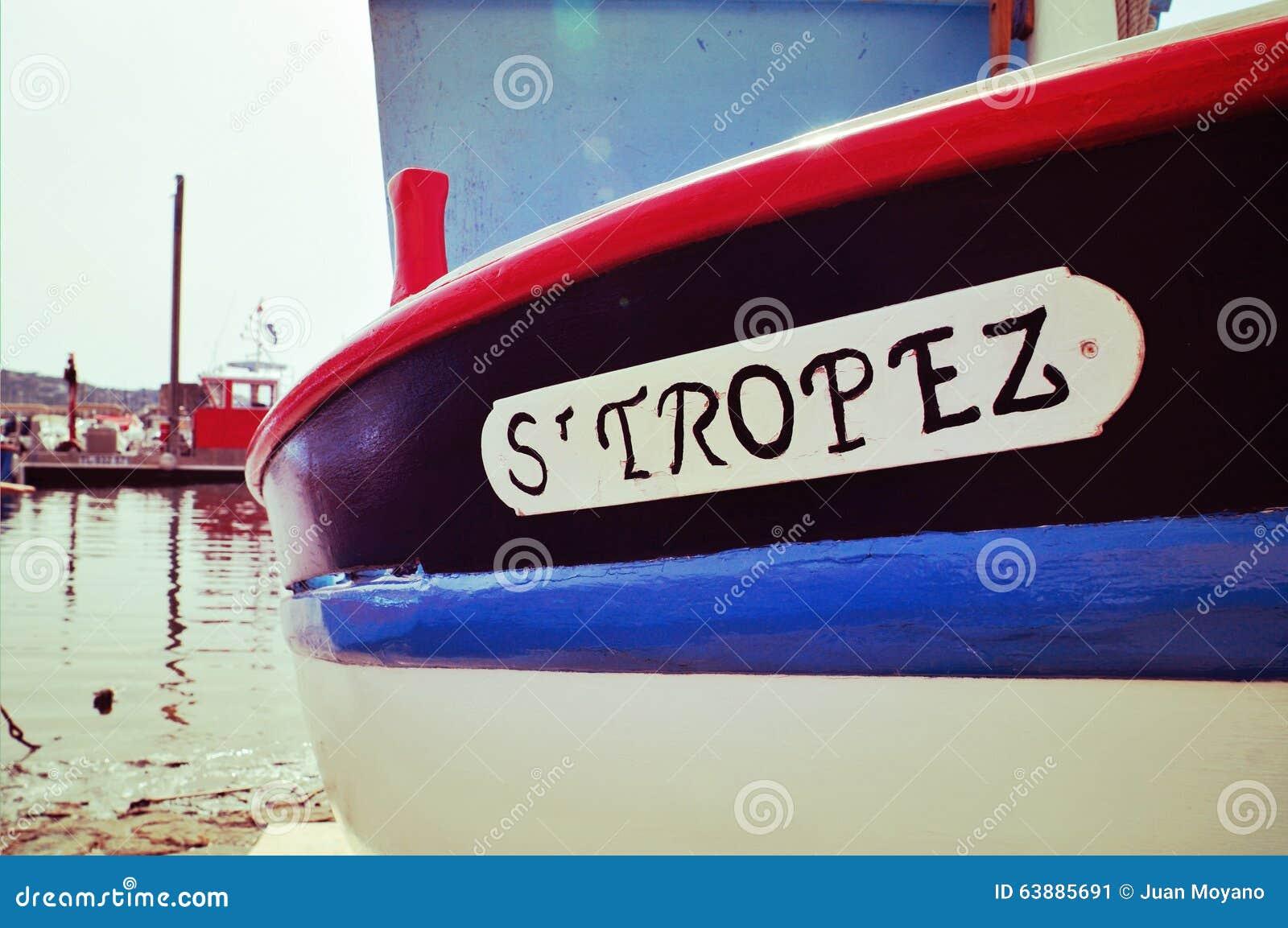 St Tropez escrito em um barco, com um efeito retro