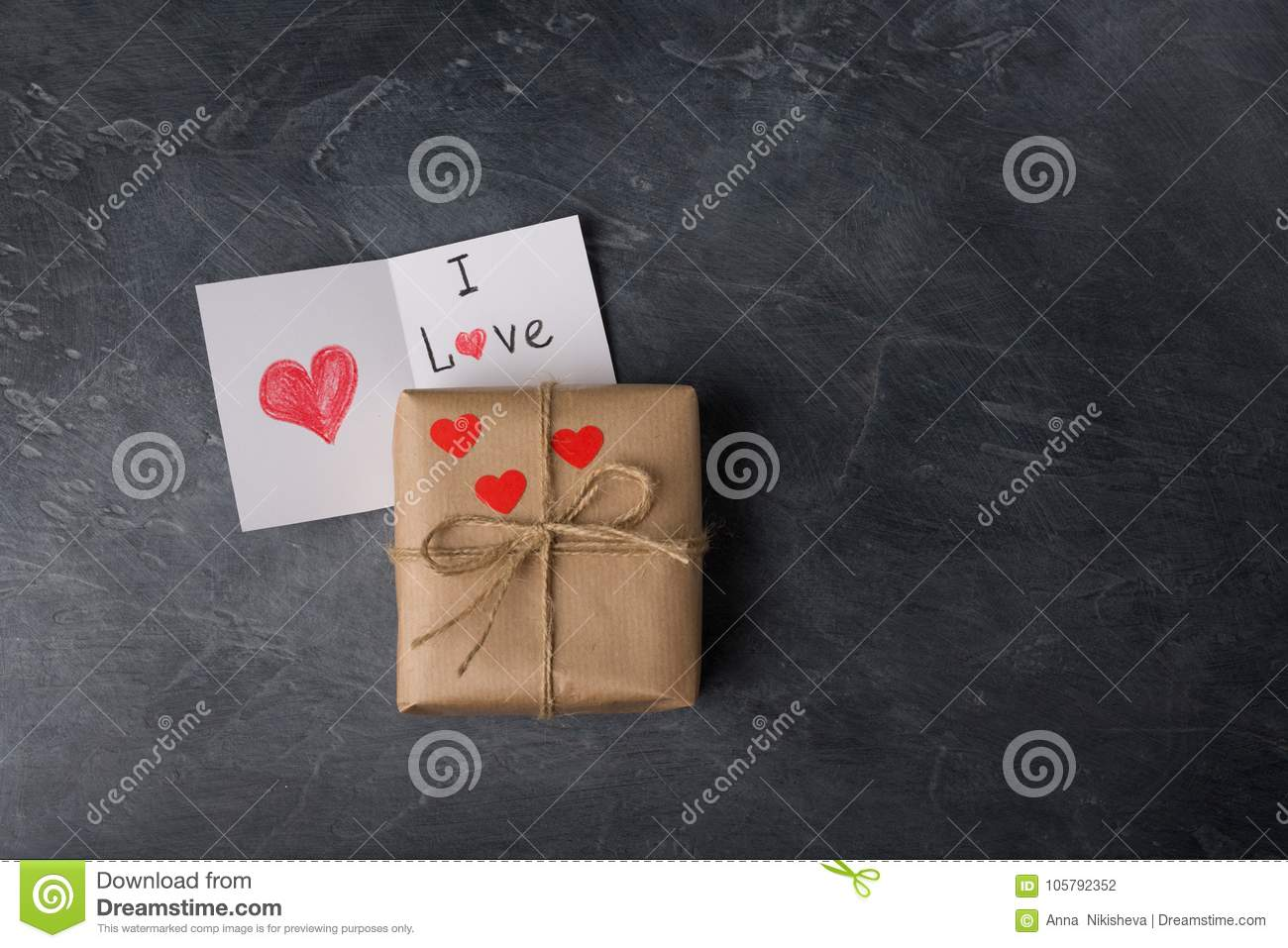 1cb26397d3444 St. Valentine Gift Box In Craft Paper, With Note On A Black Ch Stock ...