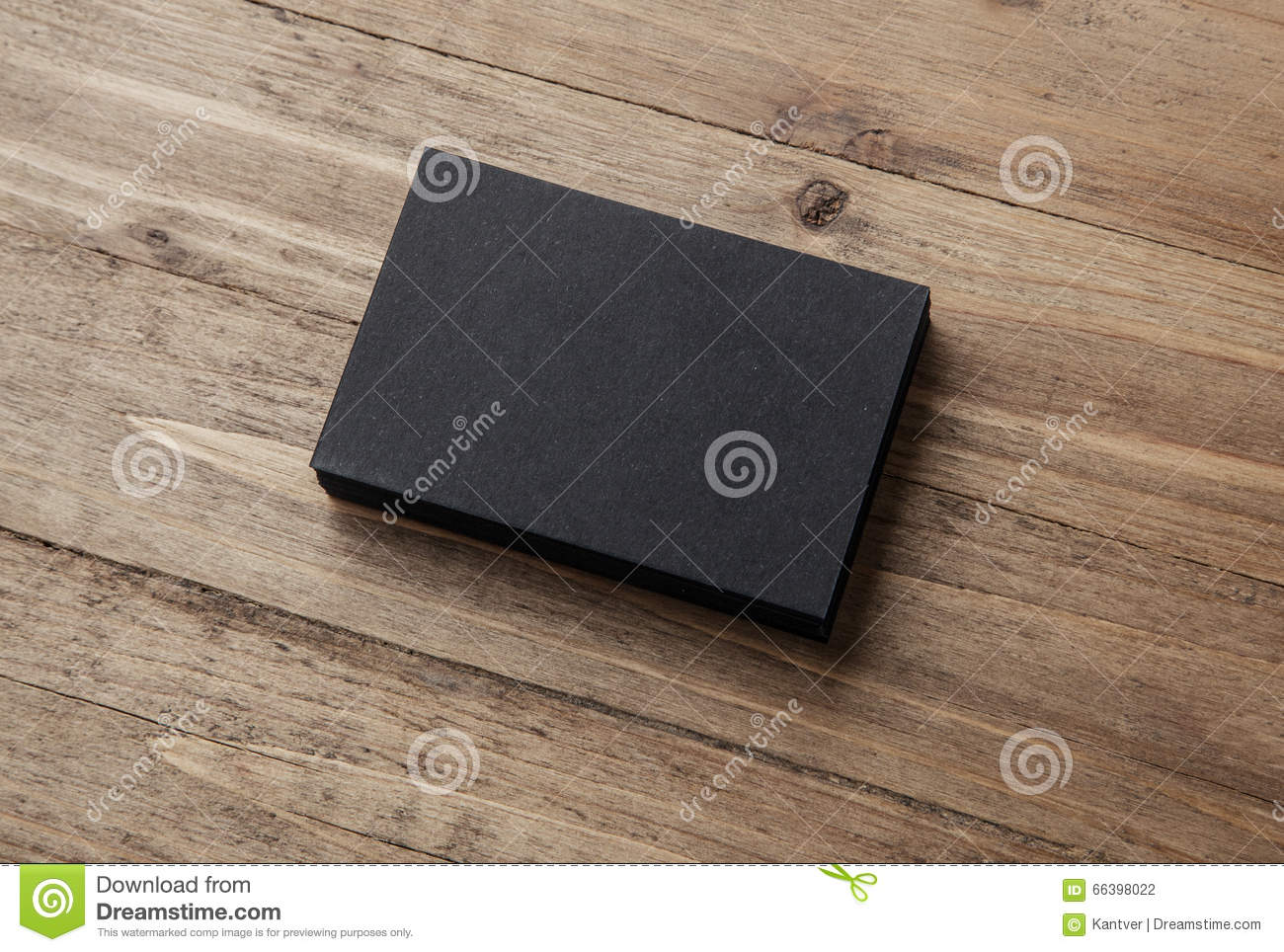 stack of blank black business cards on wooden background stock