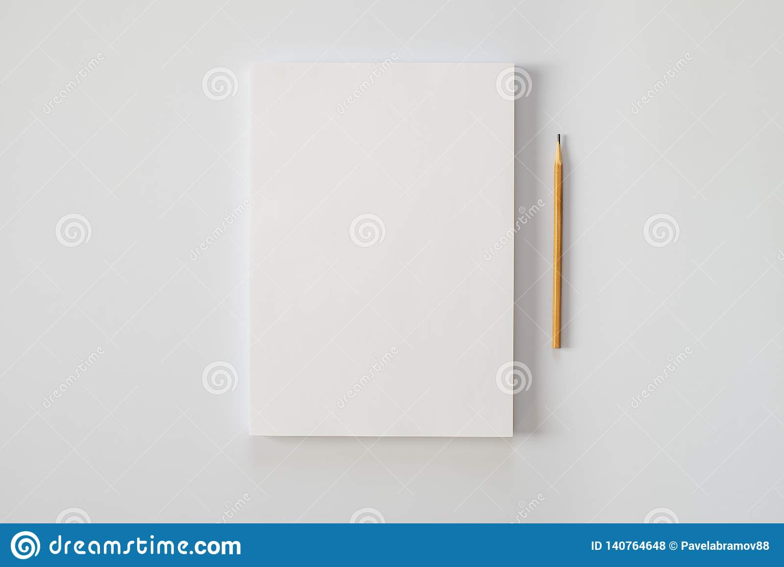 A stack of blank sheets of paper and a pencil on a white background