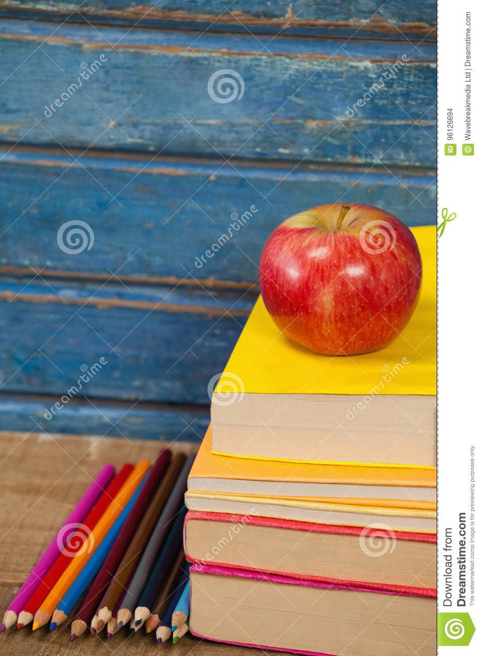 Stack Of Books, Apple And Color Pencils Stock Photo - Image of ...