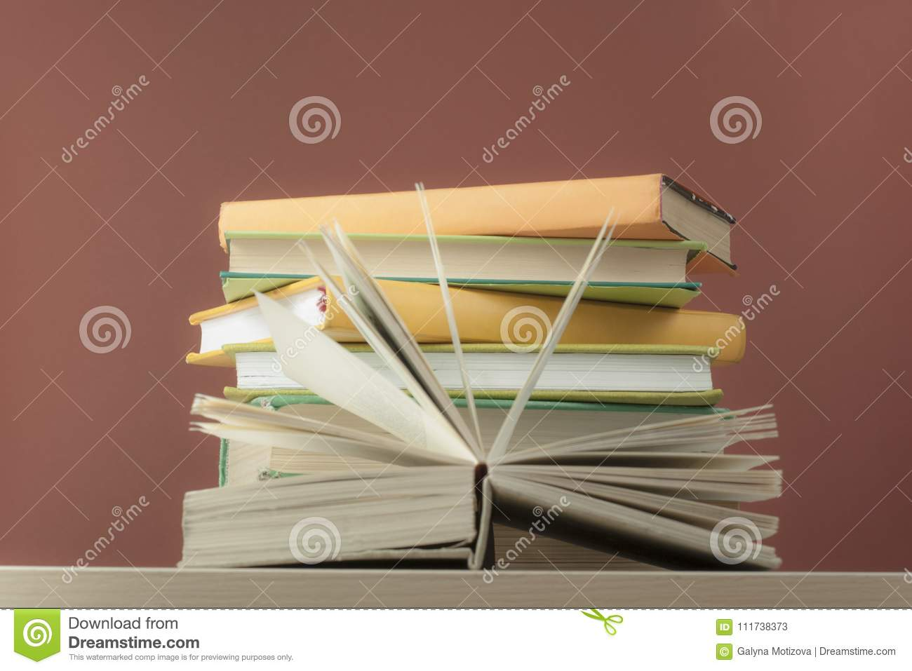 Composition Book Cover Background ~ Composition with open book hardback books on wooden table and red