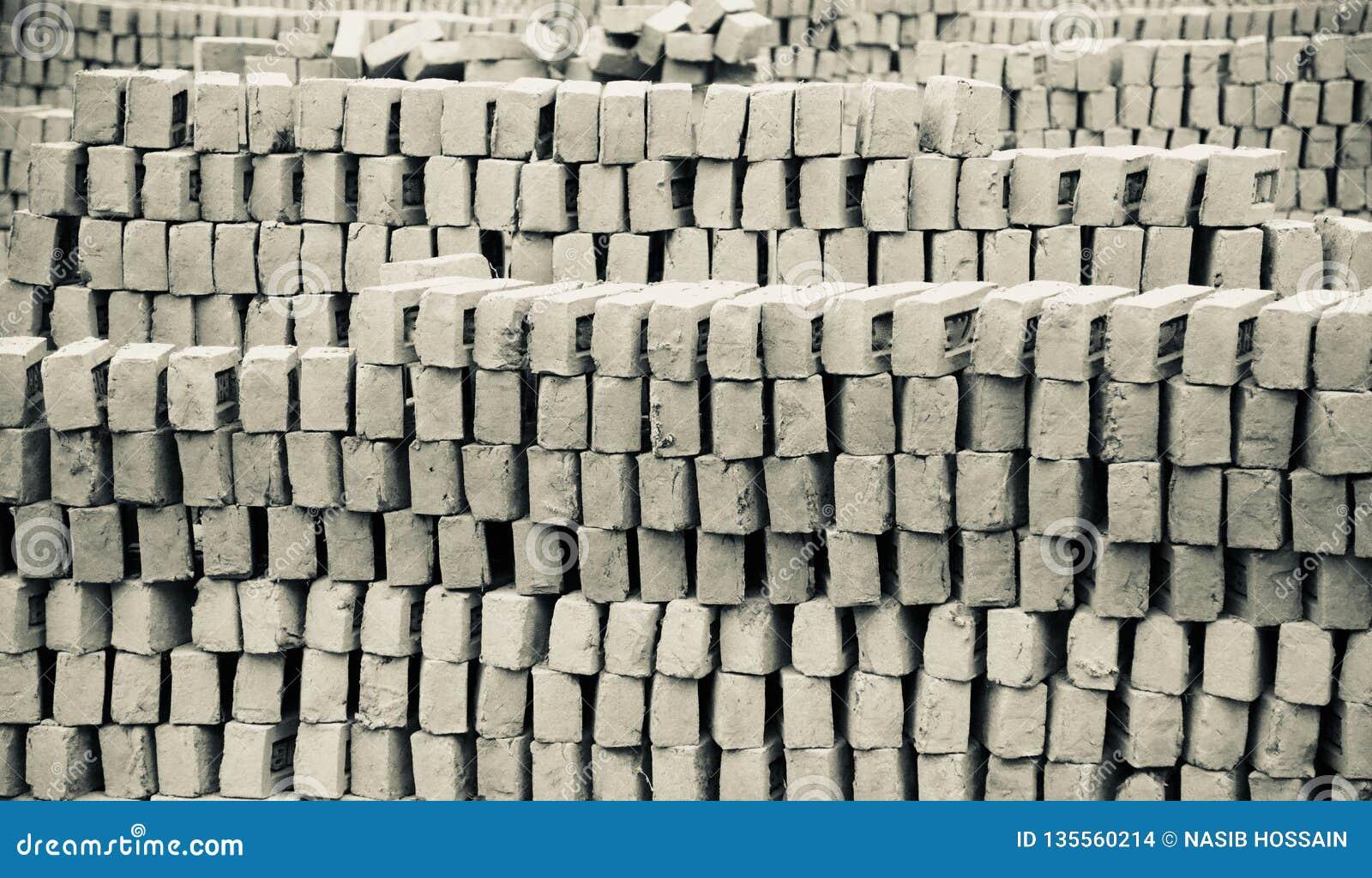 Stack of bricks around a bricks field