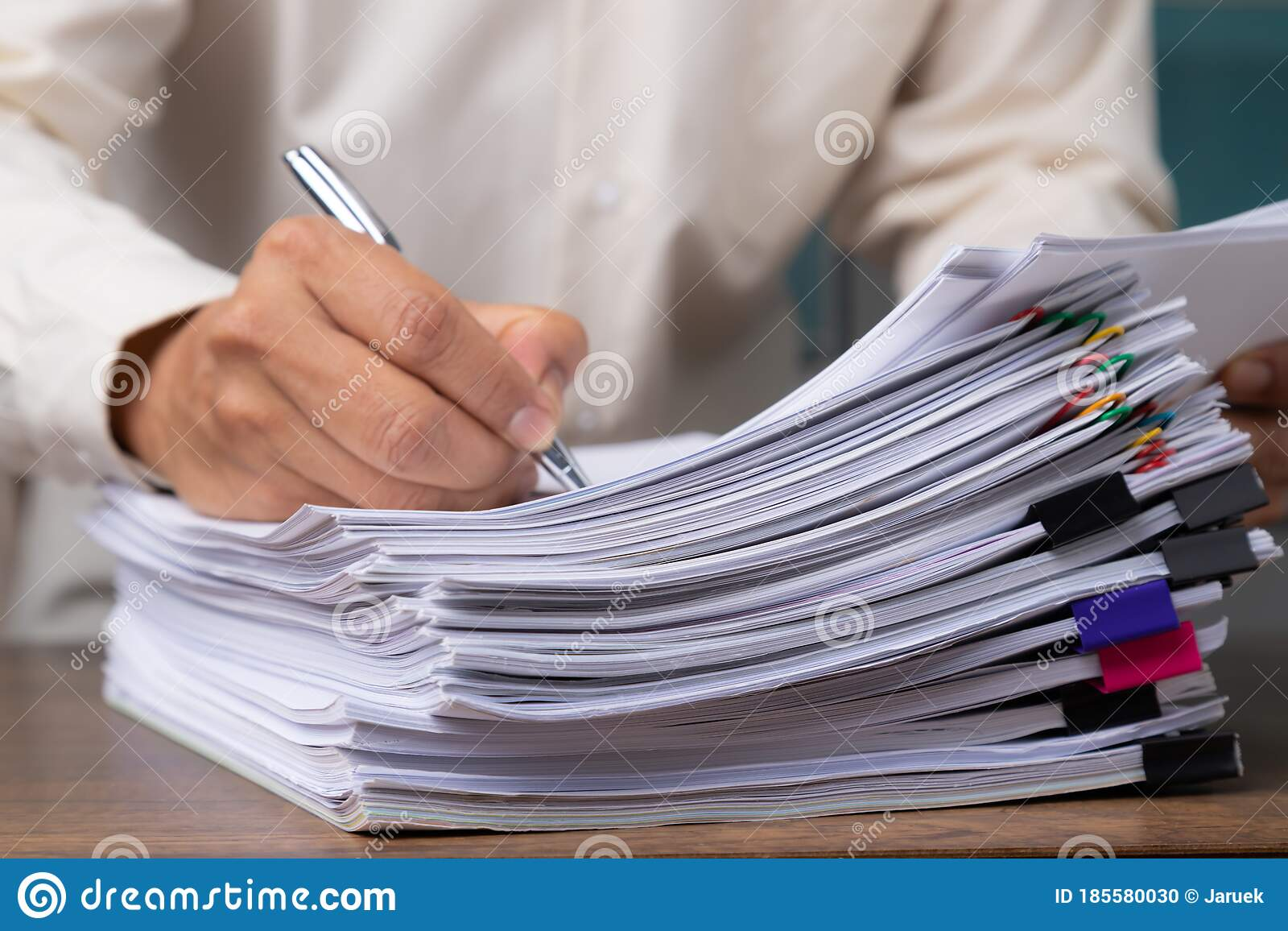 stack of business overload paper stock photo