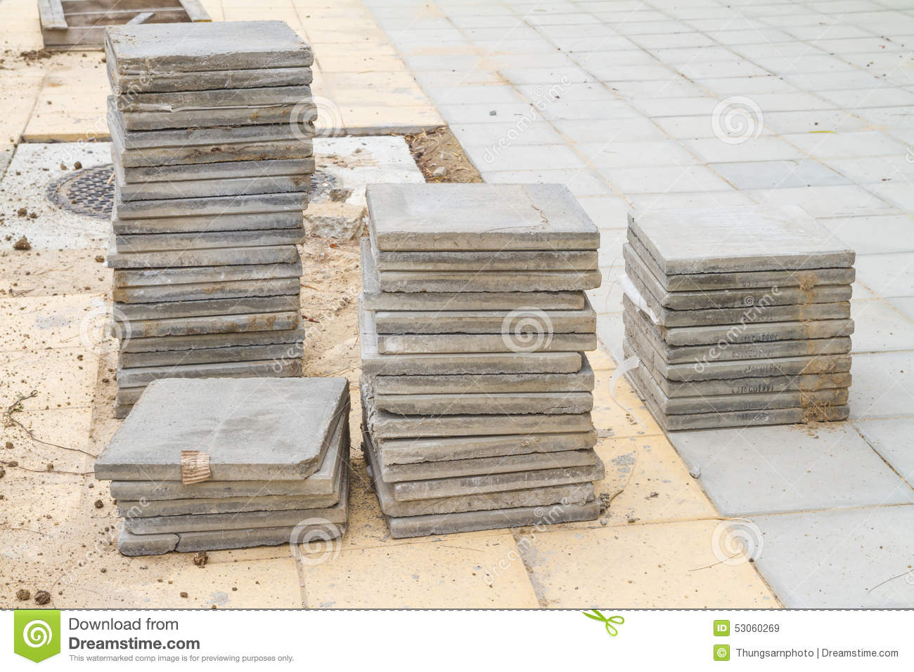 Stack of cement floor tiles at road side construction site - Baldosa de cemento ...