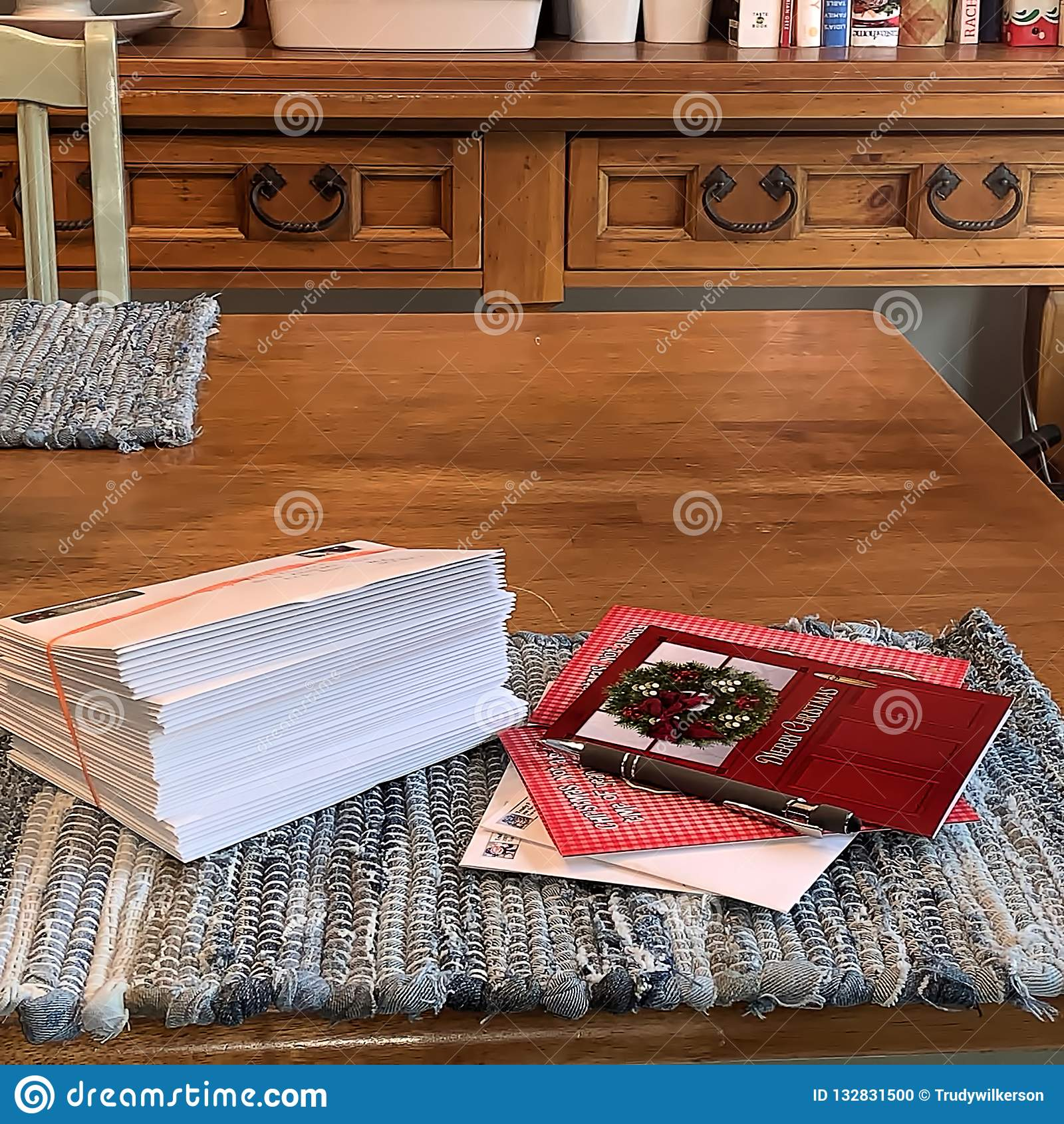 Addressed Christmas Cards.Stack Of Christmas Cards On Kitchen Table Ready To Mail