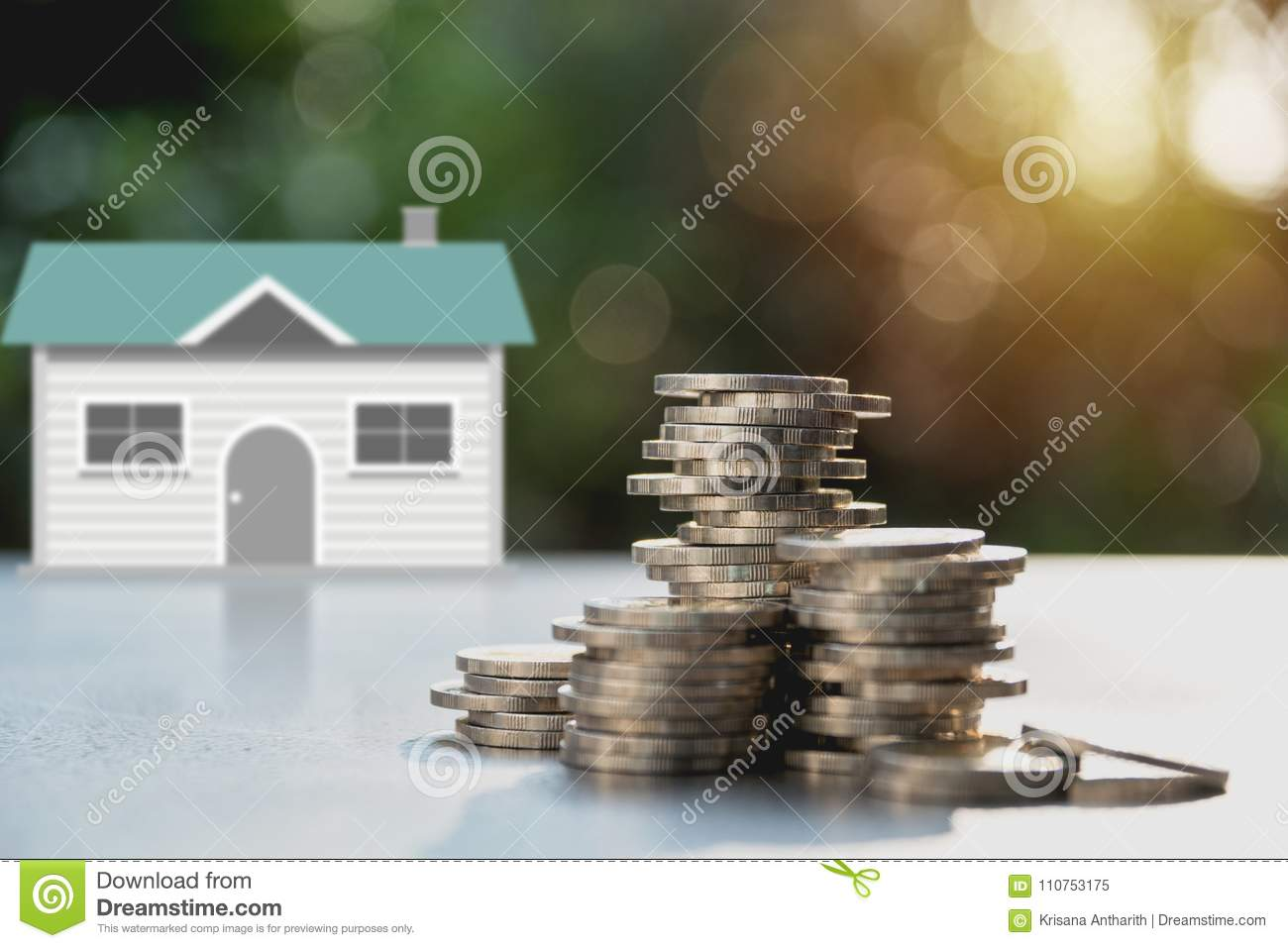 Stack of coin money with house. Save money for a house concept