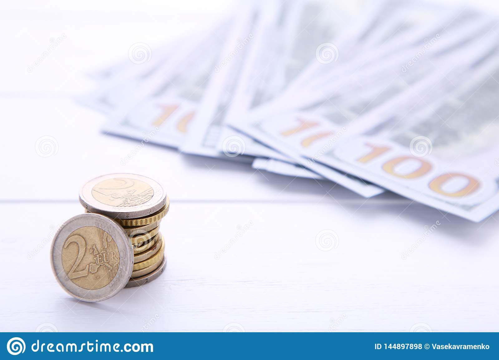 Stack of coin and money on white background