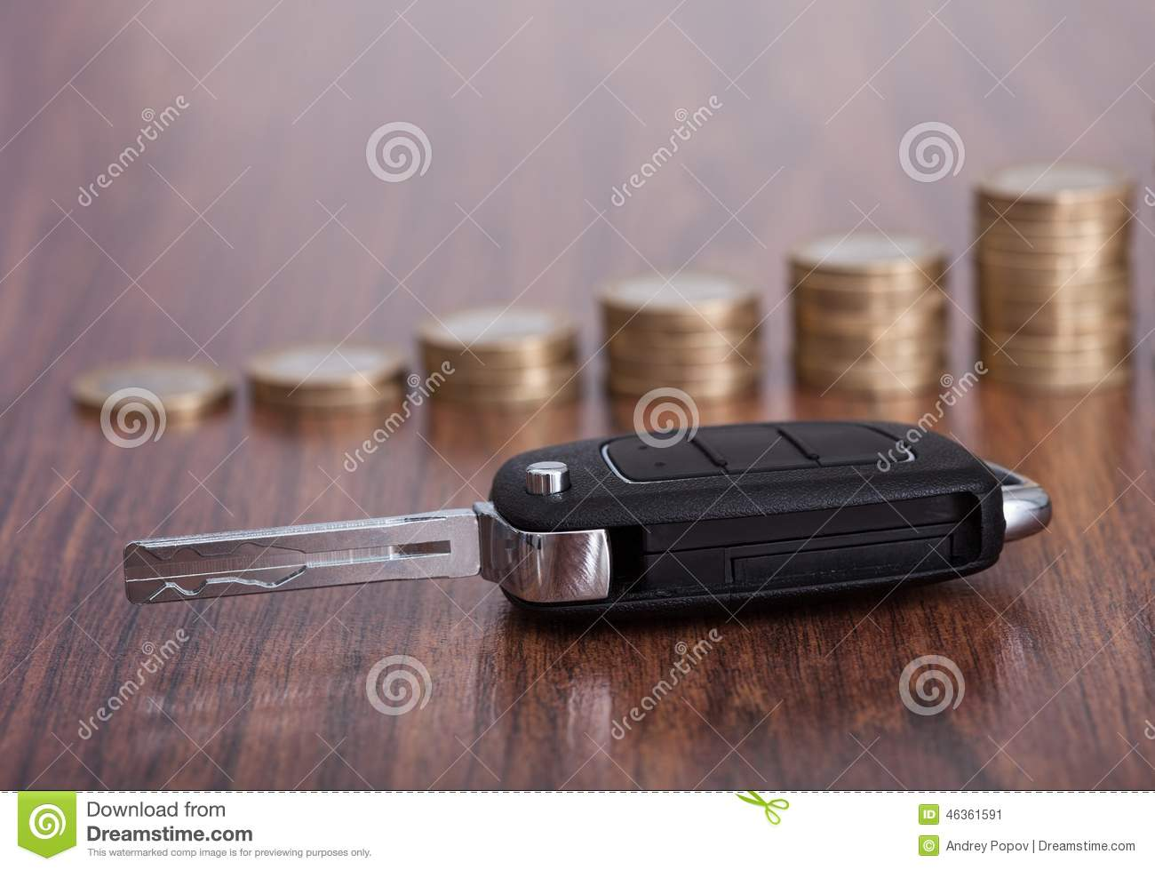 Stack of coins with car key
