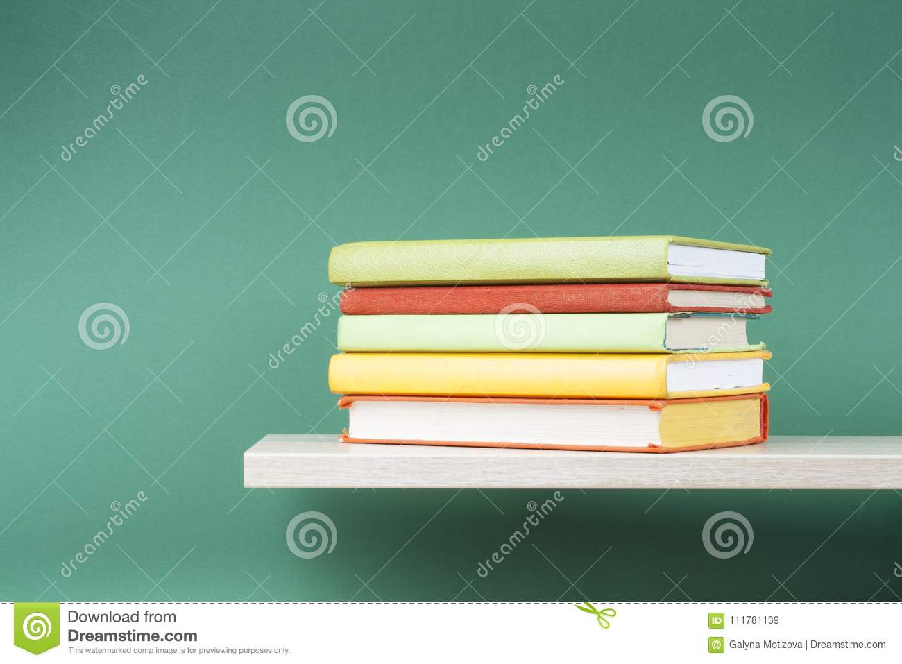 Stack of books on wooden shelf. Education background. Back to school. Copy space for text.