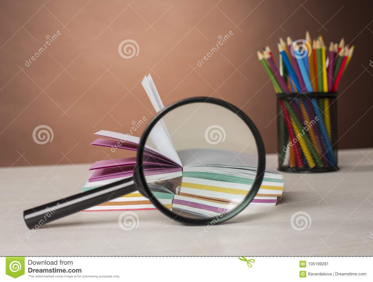 Stack Of Colorful Stickers And Magnifying Glass Stock Image