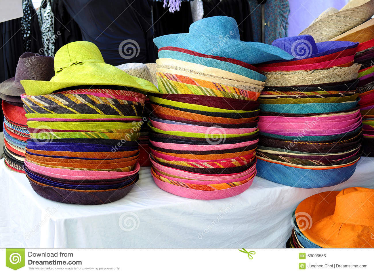 fb07c84c60a07 Stack Of Colorful Straw Hats In Market Stall Stock Photo - Image of ...