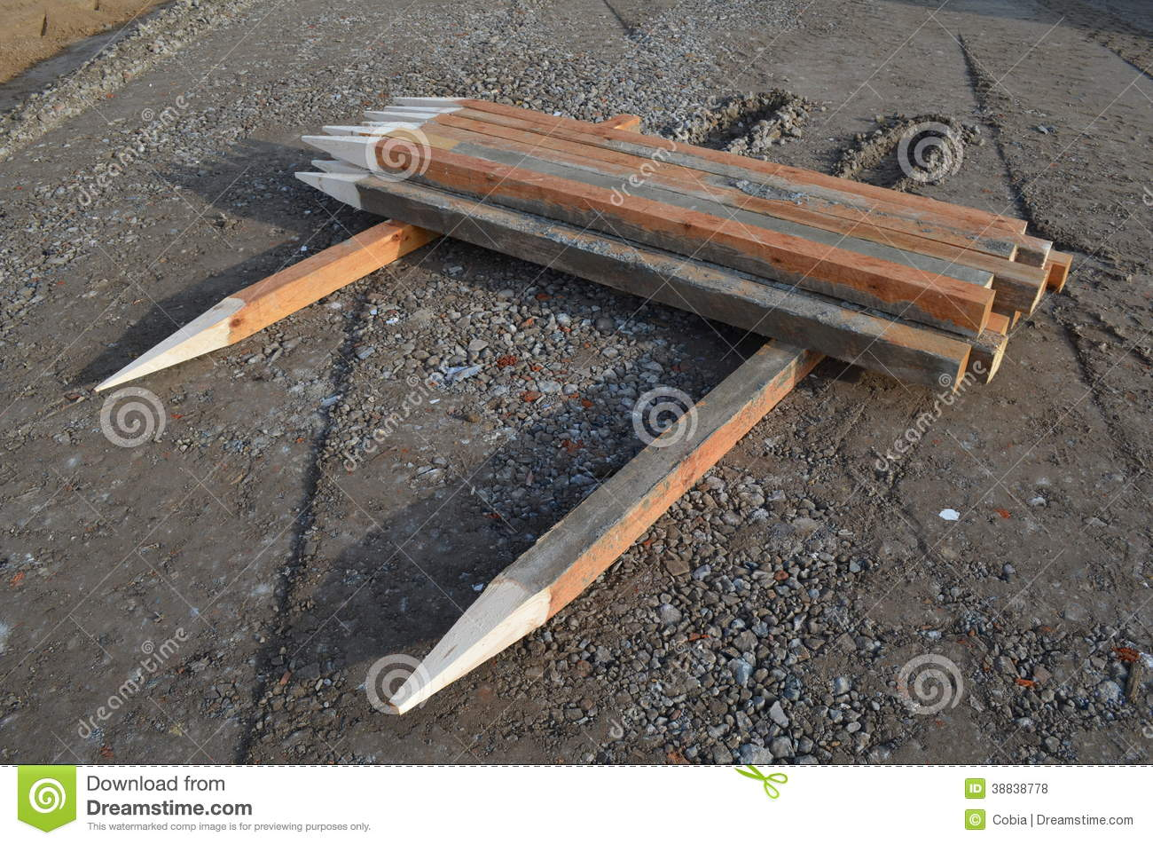 Wood Piling Construction : Stack of construction timber piles stock photo image