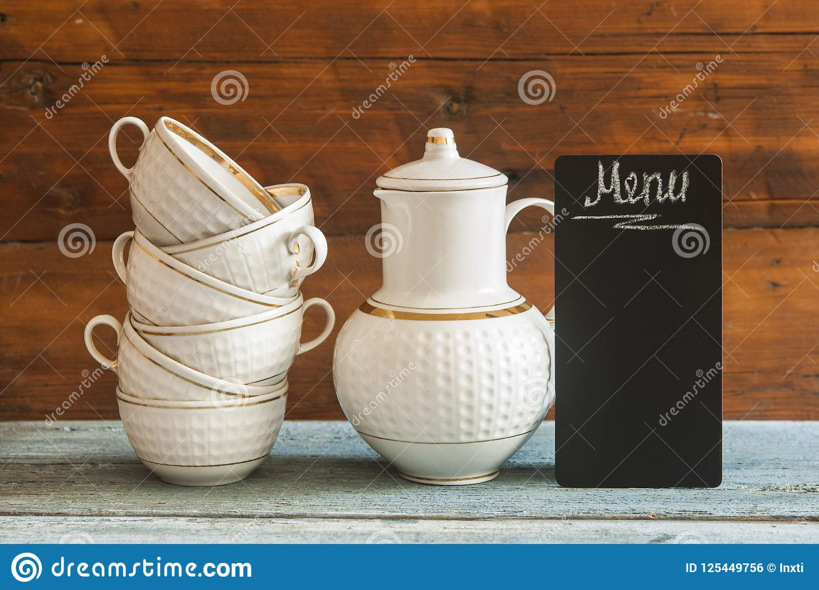 Stack Cups And Small Blackboard On Wooden Table Stock Photo Image