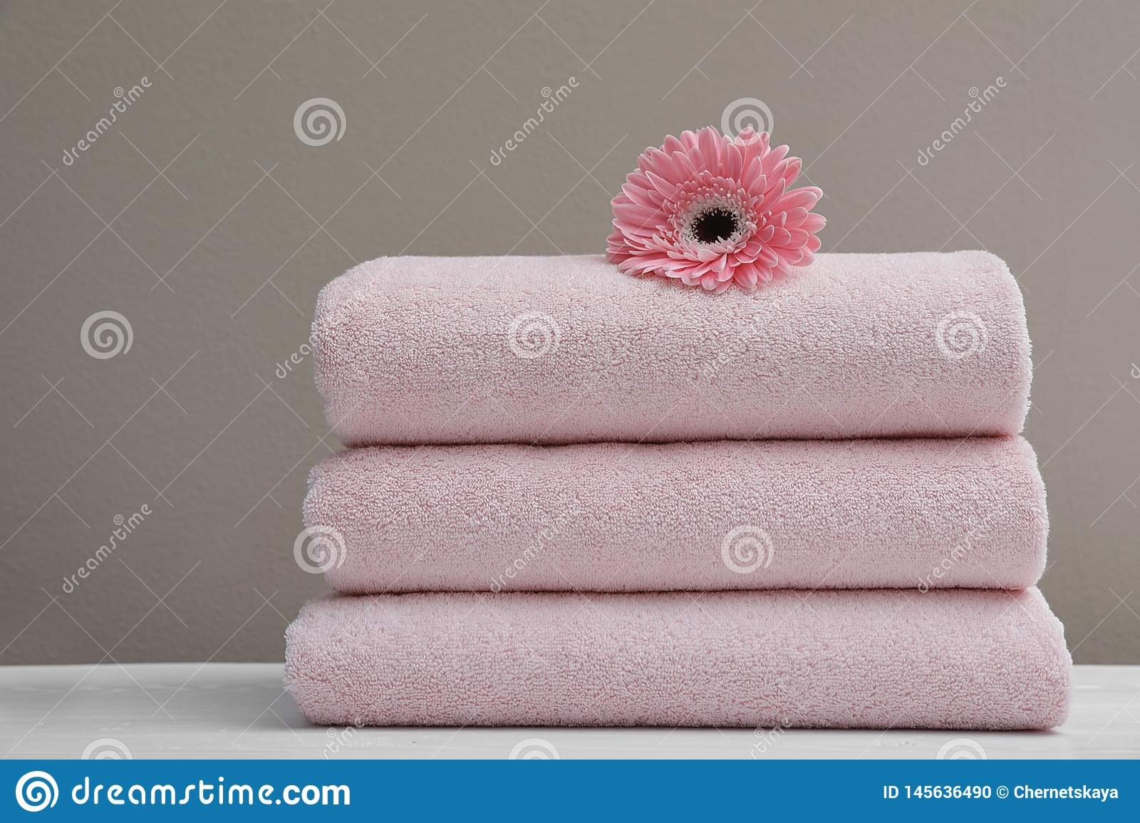 Stack of fresh towels with flower