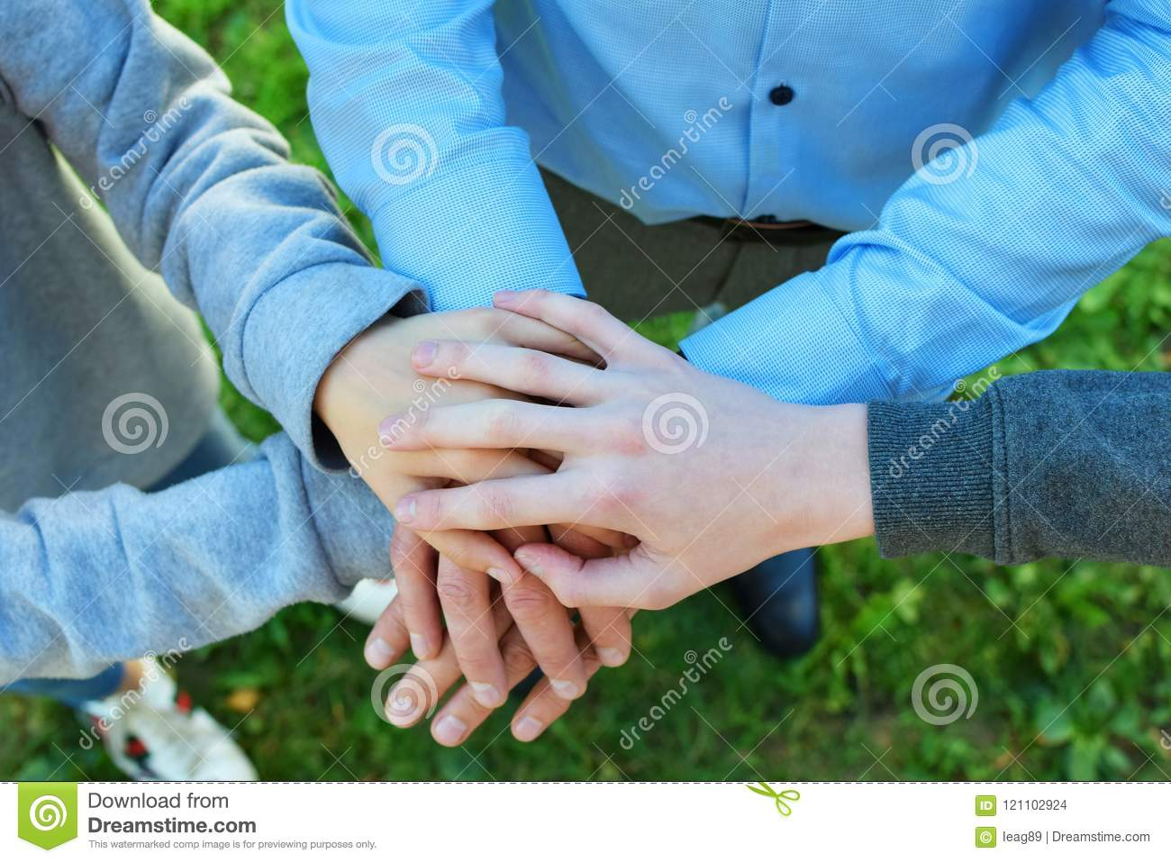 Stack Of Hands On Green Grass Stock Photo - Image of spirit