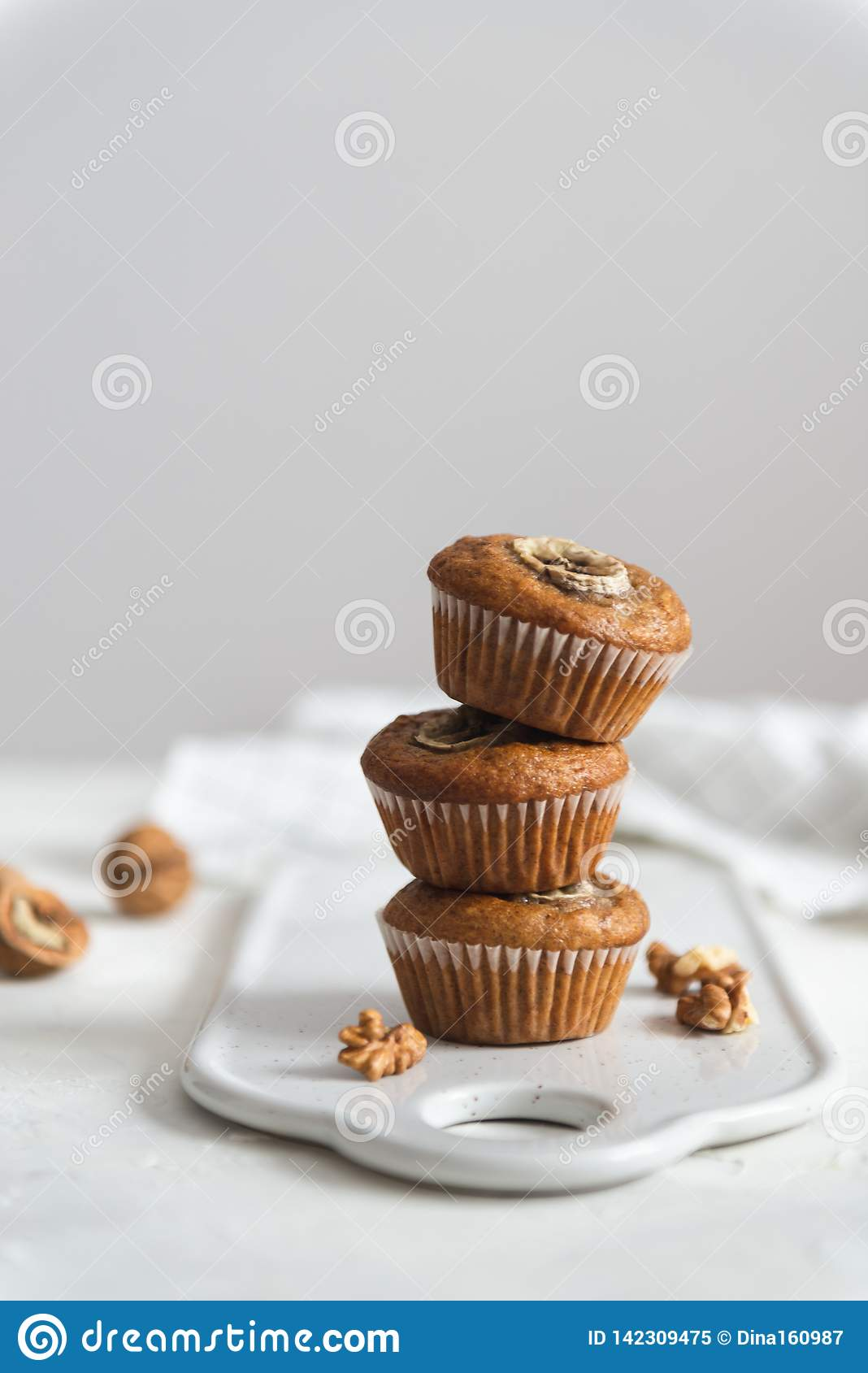 Stack of Homemade vegan banana walnut muffins. Side view, copy space