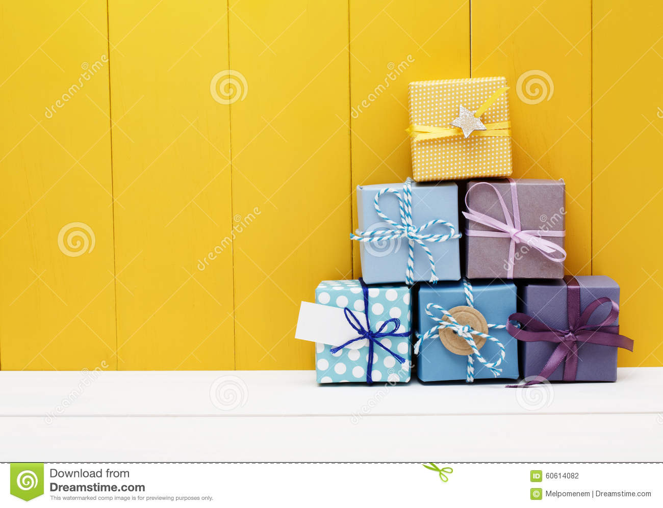 Stack of little present boxes