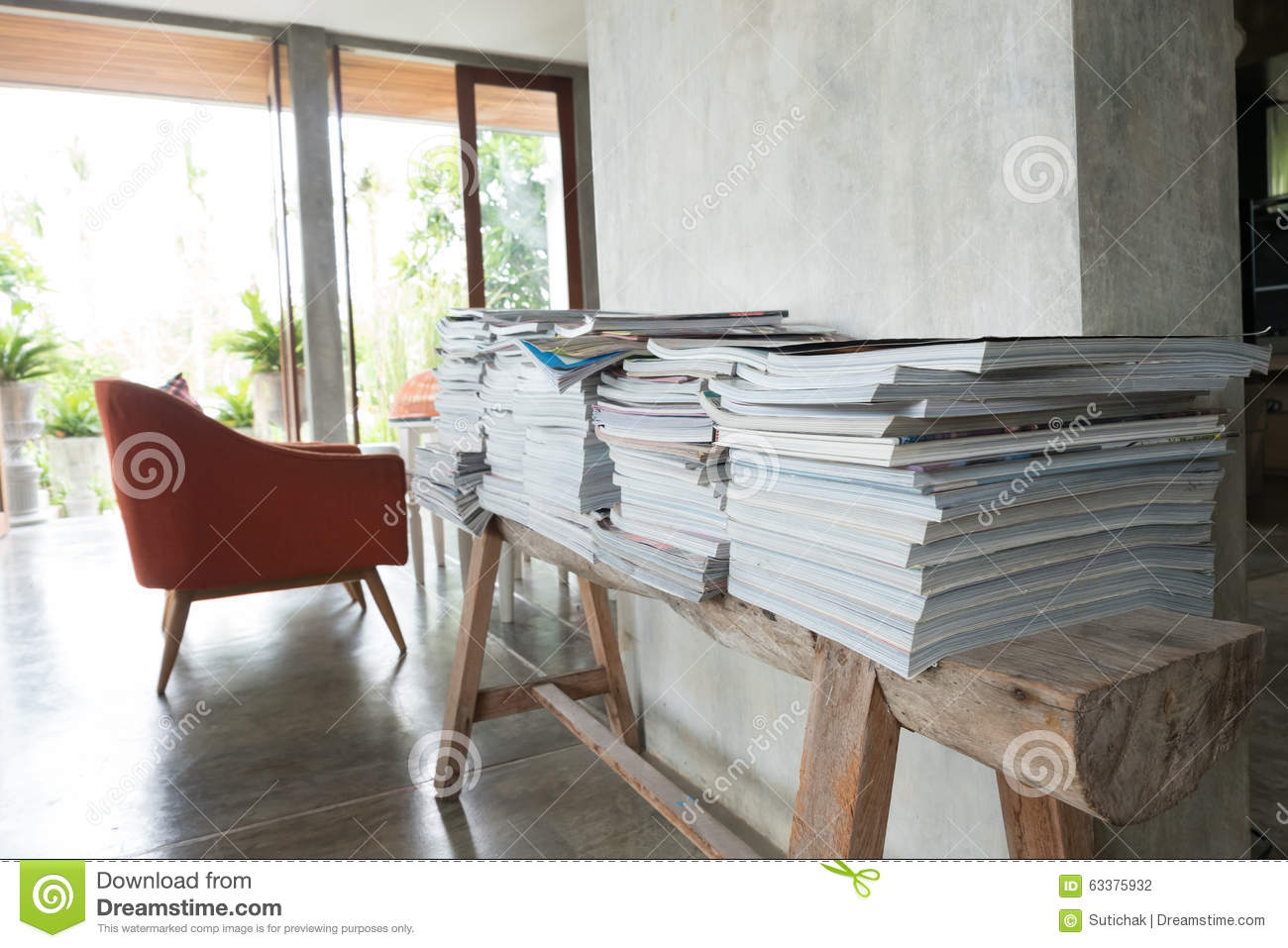 Stack Of Magazine Book On Wooden Table Shelf In Living Room Stock ...