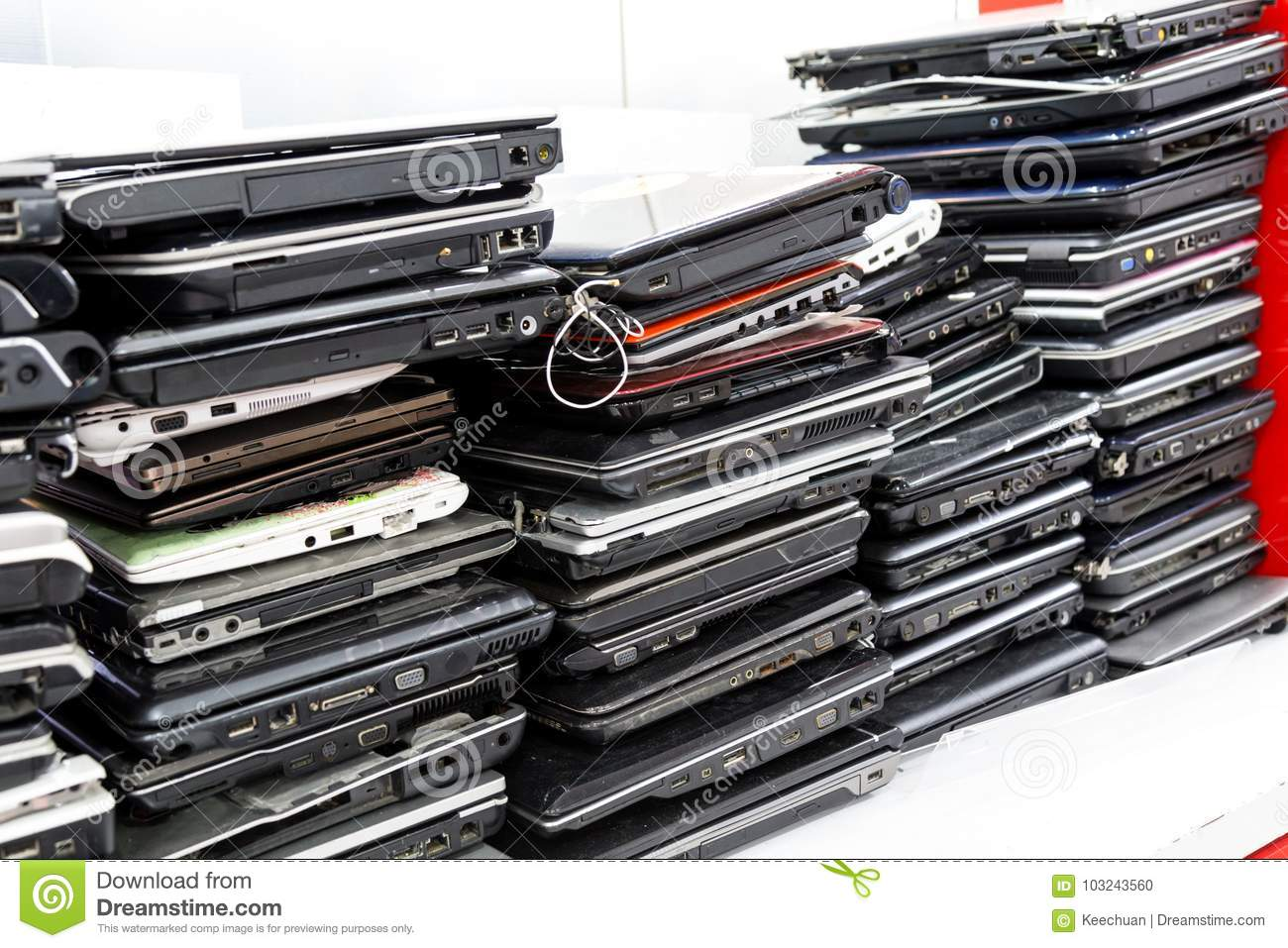 Stack of old, broken and obsolete laptop computer for repair