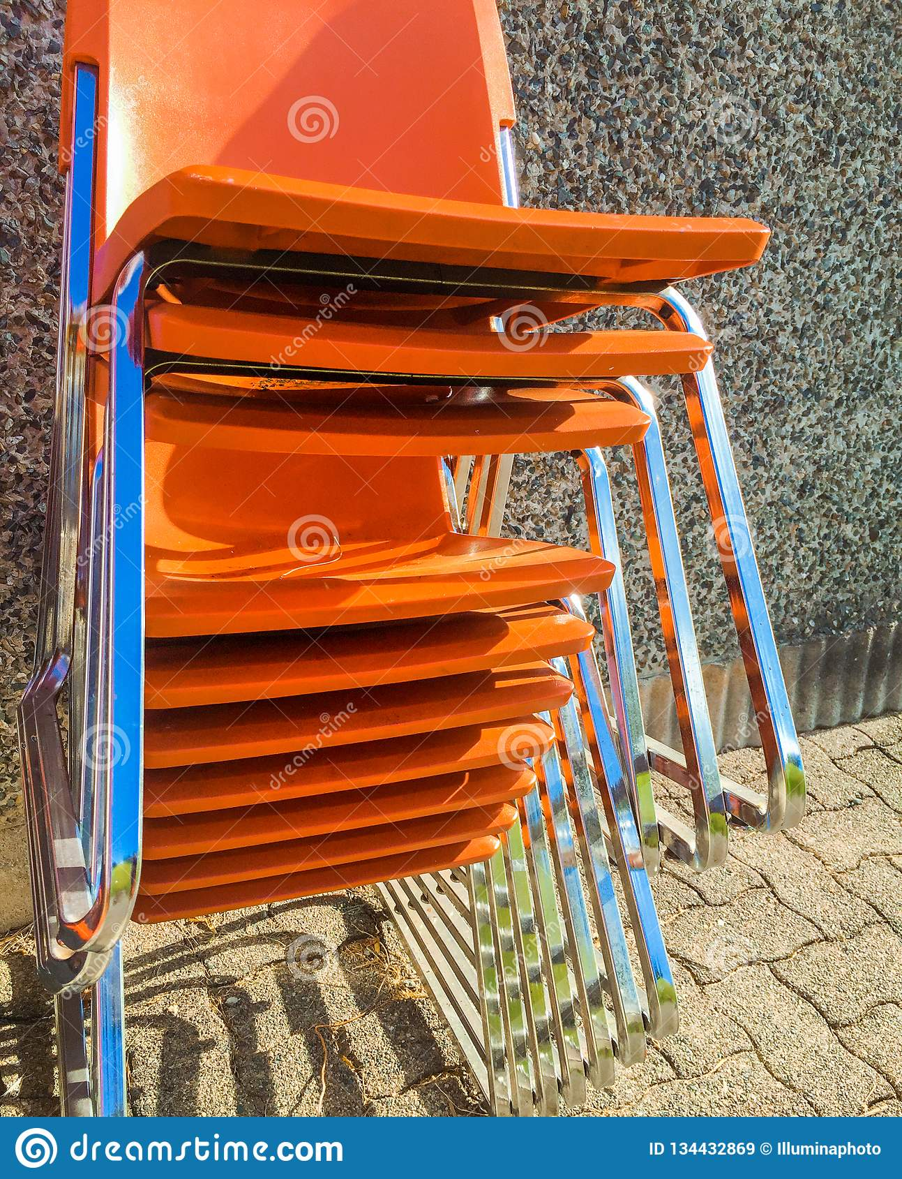 Cool Stack Of Orange Plastic Modern Chairs Outside Stock Image Machost Co Dining Chair Design Ideas Machostcouk